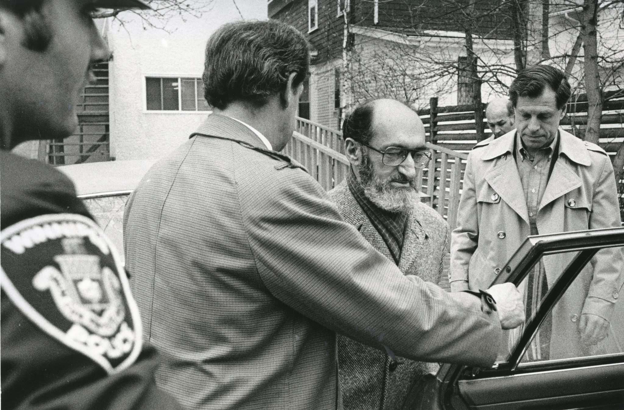 Dr. Henry Morgentaler, with Brodsky to his left, is arrested at his then-illegal abortion clinic in 1985 following a police raid.