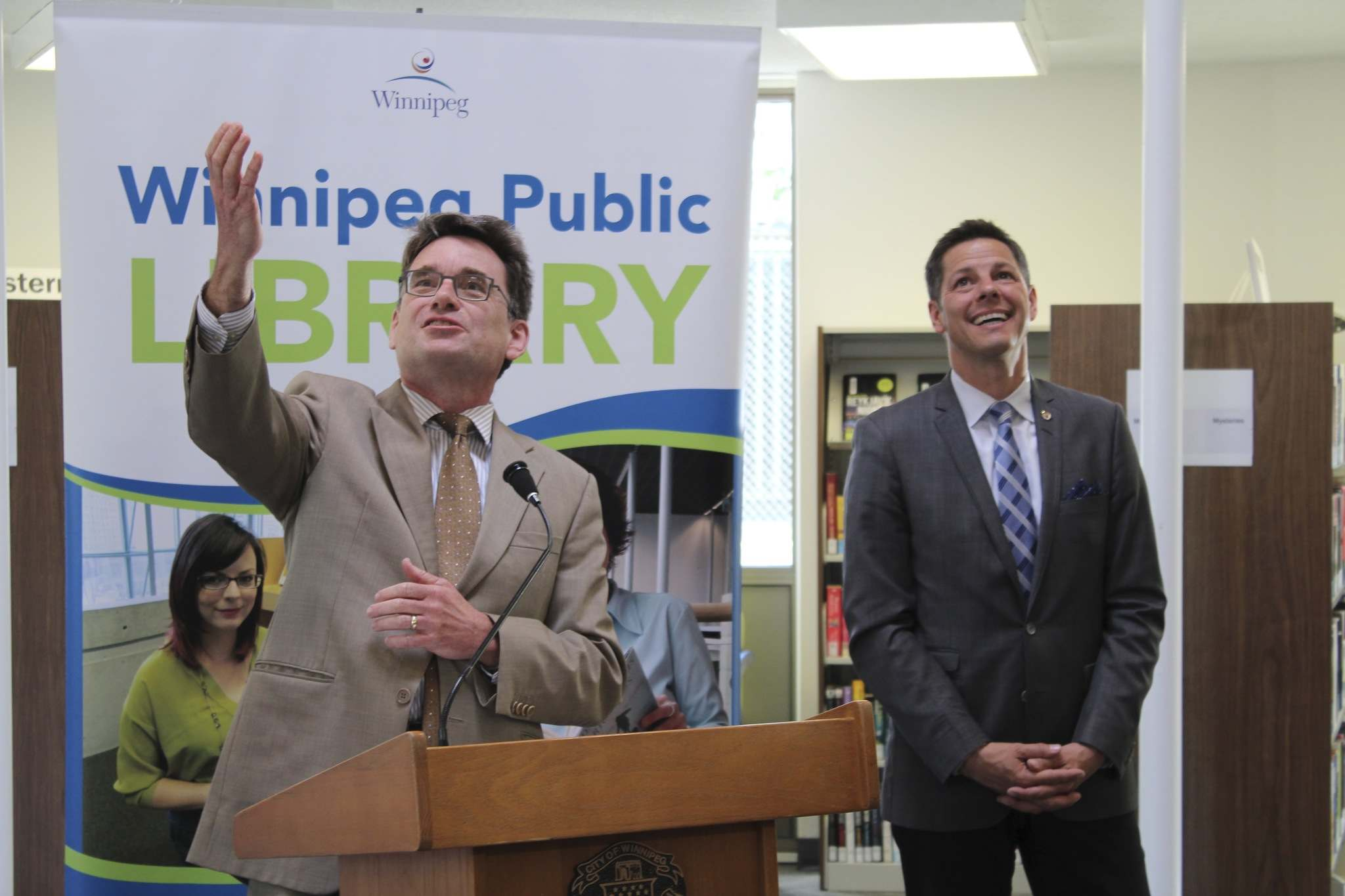 MAGGIE MACINTOSH / WINNIPEG FREE PRESS</p><p>Coun. Brian Mayes (left), seen with Mayor Brian Bowman at the St. Vital Library reopening on Monday, said his favourite part of the library's renovation is the new elevator.</p>