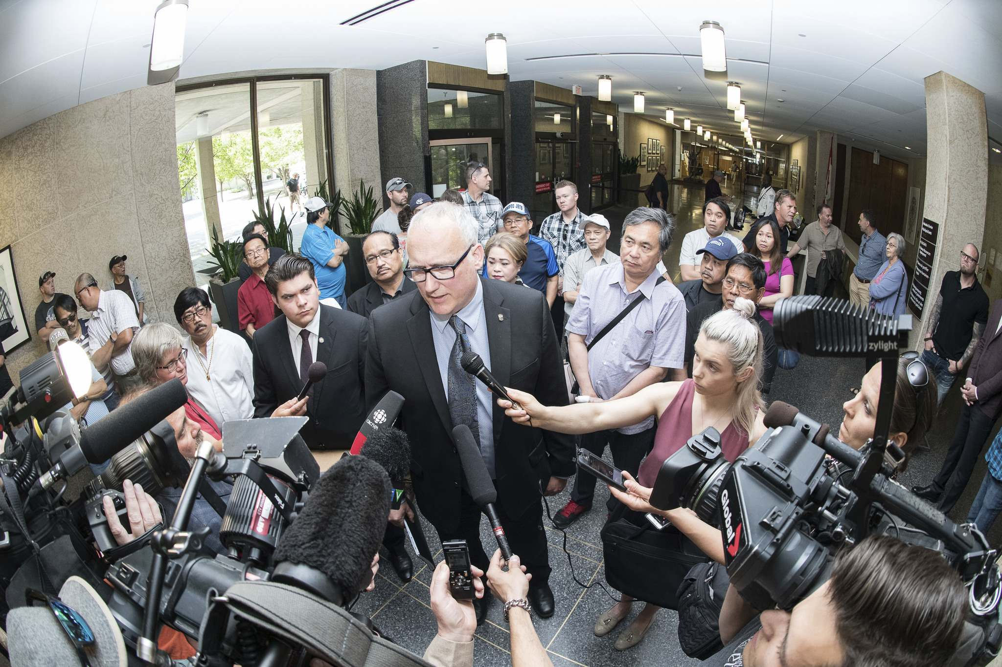 MIKE SUDOMA / WINNIPEG FREE PRESS</p><p>Police officer Tim Diack, surrounded by supporters, talks to reporters at city hall Thursday.</p>