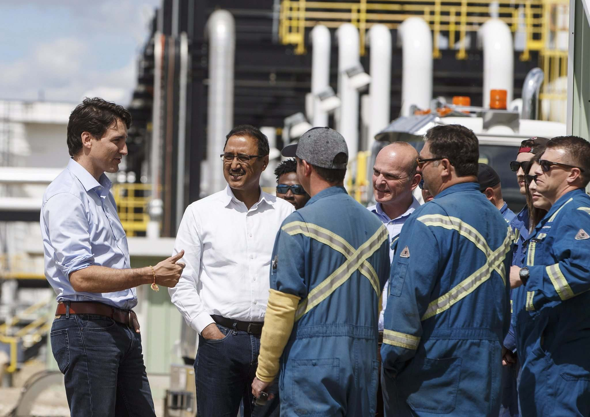 Jason Franson / The Canadian Press</p><p>Prime Minister Justin Trudeau meets with workers at the Kinder Morgan terminal in Edmonton on Tuesday.</p>