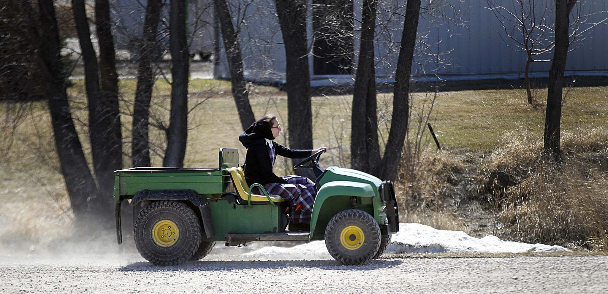 "PHIL HOSSACK / Winnipeg Free Press</p><p>A community member moves around the colony on a ""quad"" at James Valley Hutterite Colony.</p>"