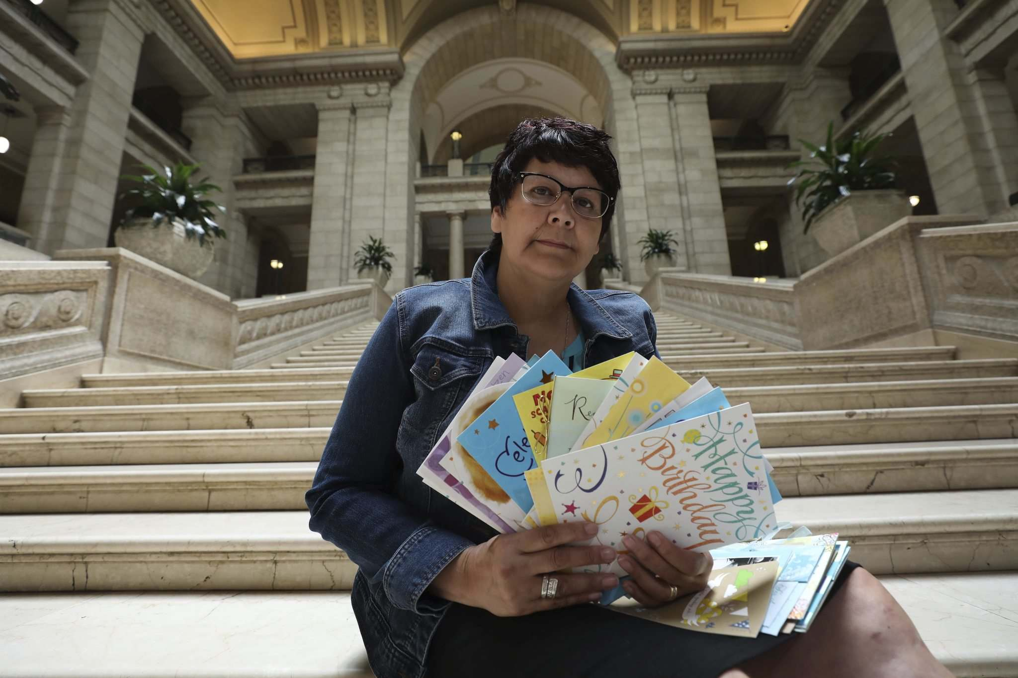 RUTH BONNEVILLE / WINNIPEG FREE PRESS</p><p>Chief Cathy Merrick of Cross Lake First Nation holds birthday cards on the steps of the Legislative Building Thursday. For Saturday story about Cross Lake's proposed health complex. Background info:Hundreds of birthday cards have been collected for the health minister from people from Cross Lake who are yearning for provincial funds to help build a health complex.</p><p>See story by Jessica Botelho-UrbanskiManitoba Legislature Reporter</p><p>June 14, 2018</p>