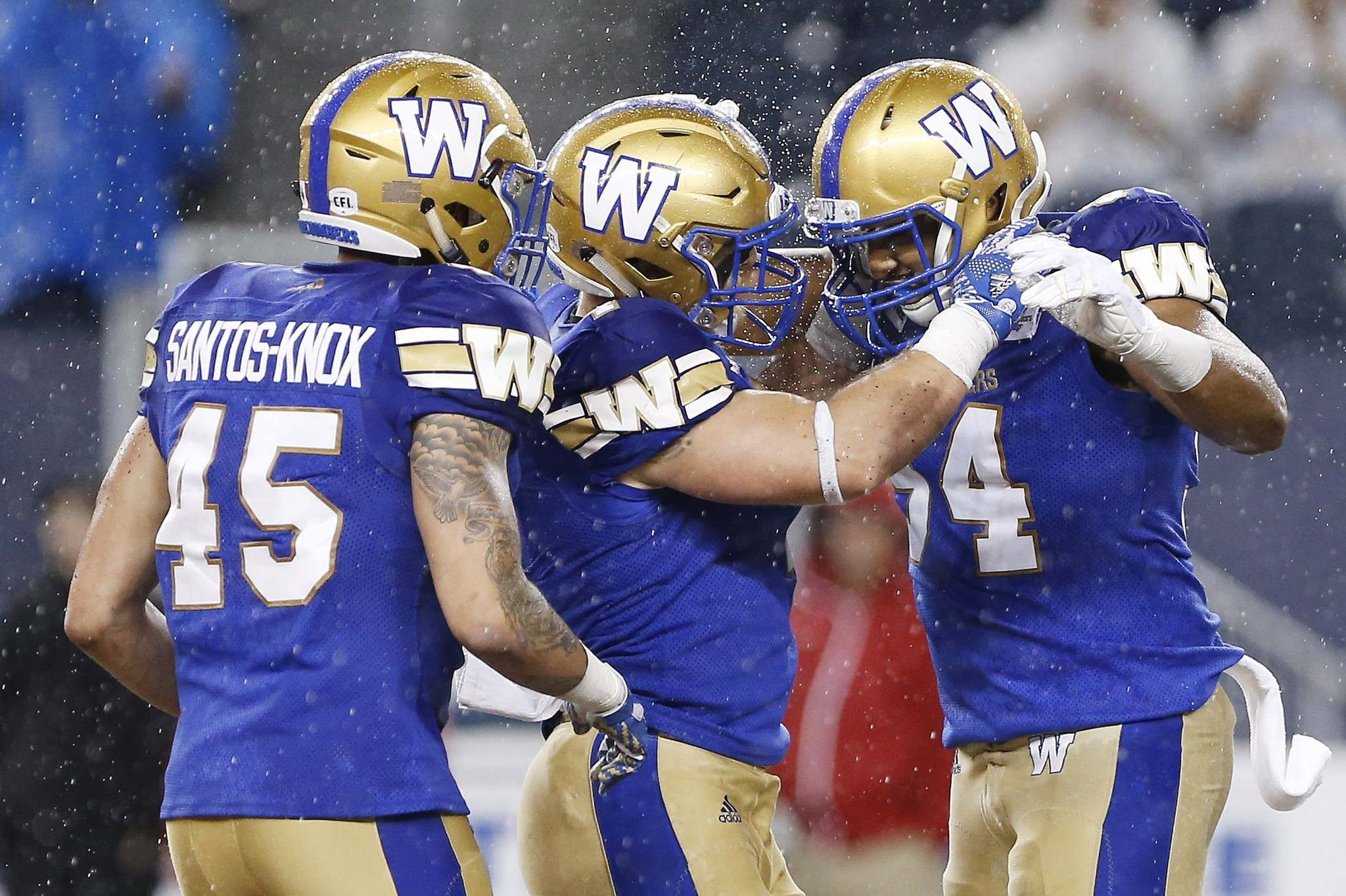 THE CANADIAN PRESS/John Woods</p><p>Winnipeg Blue Bombers' Jovan Santos-Knox (45), Adam Bighill (4) and Jackson Jeffcoat (94) celebrate a sack against the Edmonton Eskimos during the first half of CFL action in Winnipeg Thursday, June 14, 2018. </p>
