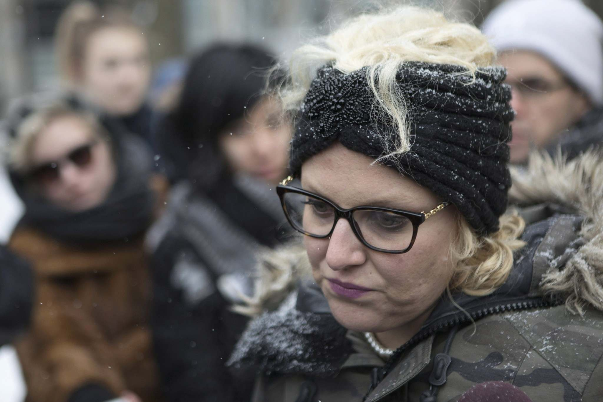 Mandi Gray stands with supporters as she talks with media outside a Toronto court on March 14, 2017, as Mustafa Ururyar appealed his sexual assault conviction. (Chris Young / The Canadian Press Files)