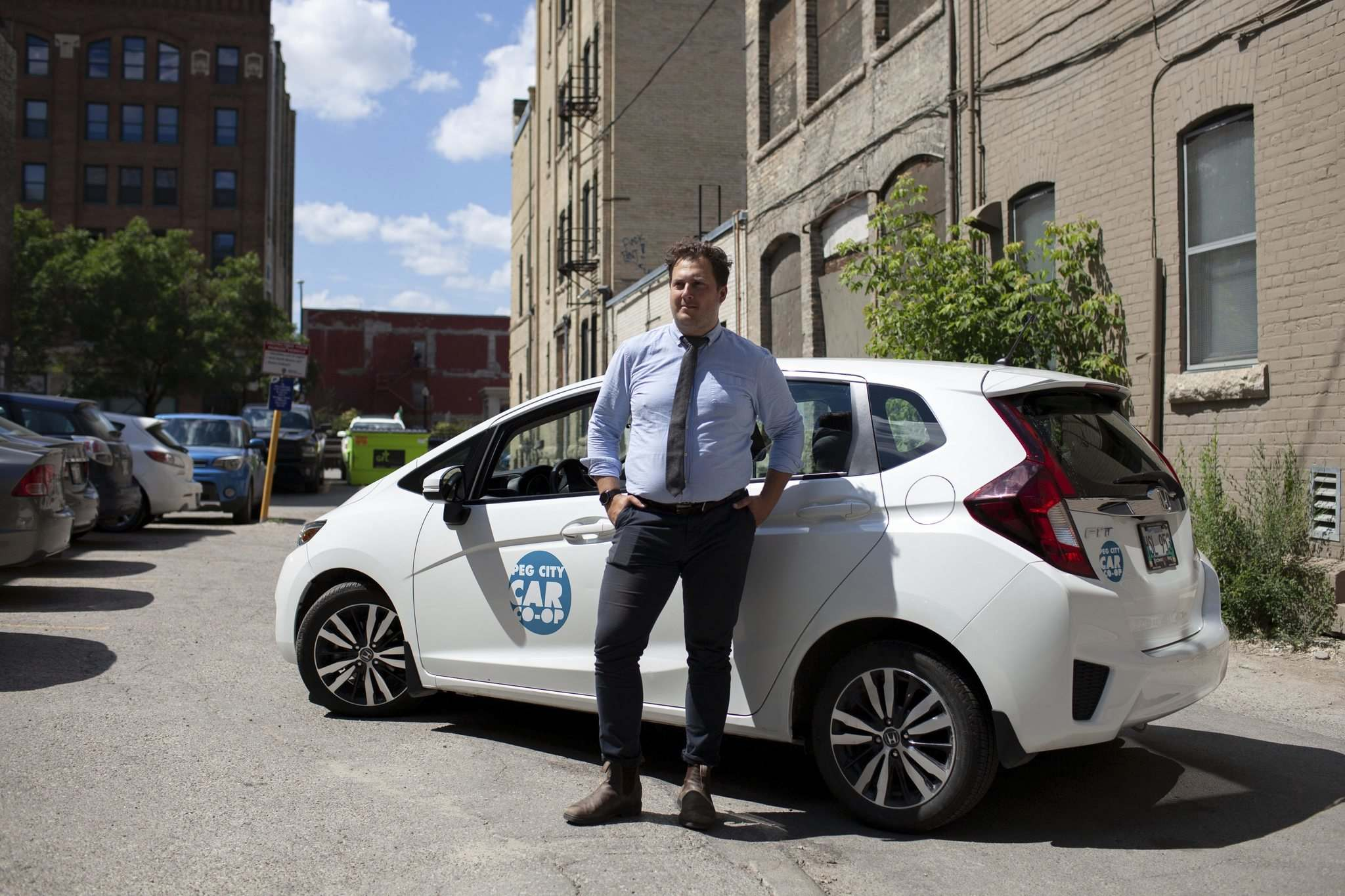 ANDREW RYAN / WINNIPEG FREE PRESS</p><p>Philip Mikulec, operations manager for Peg City Car Co-op, stands beside one of the group&rsquo;s vehicles. The co-op has expanded its fleet from three vehicles in 2011 to 26 today.</p></p>