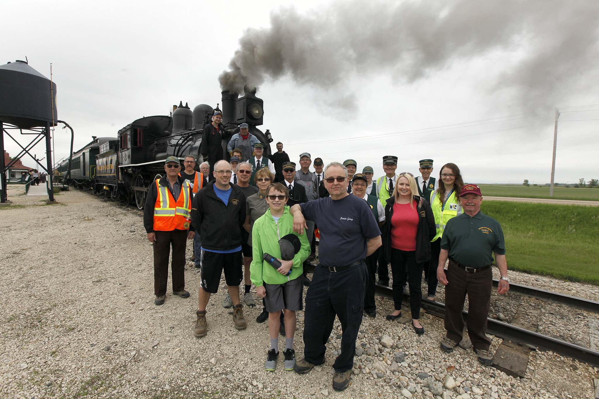 PHIL HOSSACK / WINNIPEG FREE PRESS</p><p>Prairie Dog Central volunteers and society members pose in front of engine No. 3.</p></p>