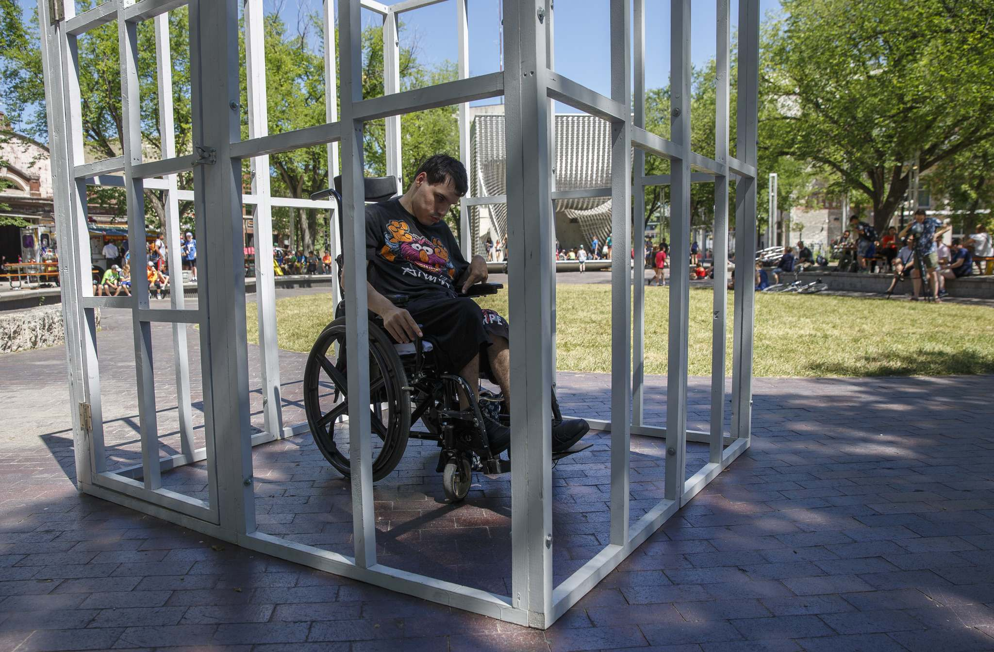 Tyson Sylvester, 22, put himself in a mock jail cell Thursday in Old Market Square to demonstrate what it&#39;s like to live in isolation as a person with a disability. (Mike Deal / Winnipeg Free Press)</p>