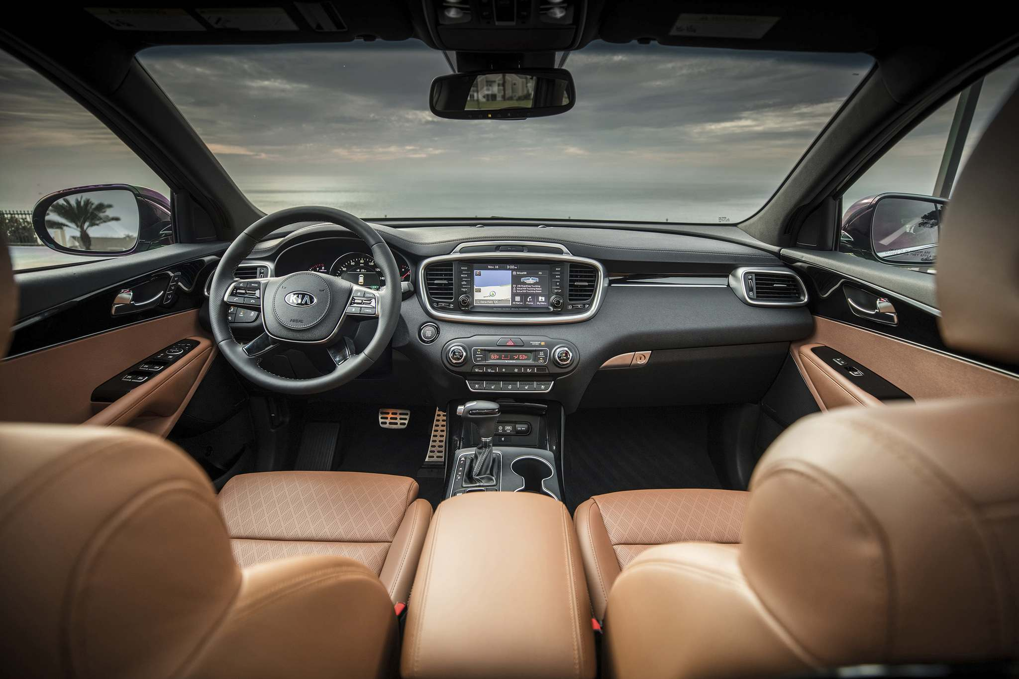 KiaThe comfortable Kia SUV features a heated leather steering wheel and heated front- and middle-row seats on the SX and higher trims.