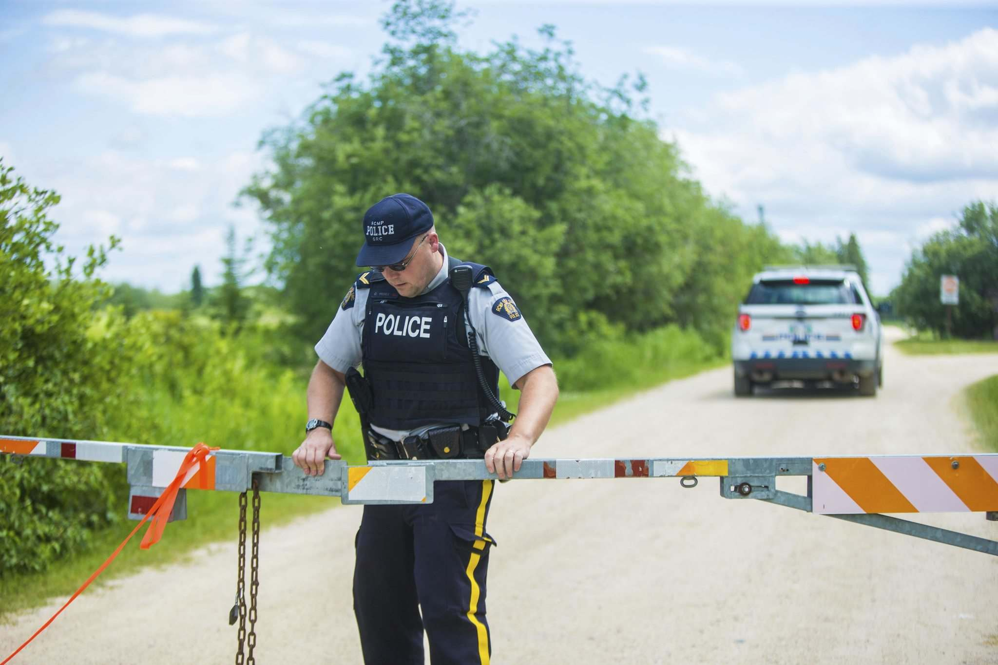 <p>RCMP close the entrance to the Pinawa Dam site after a body was recovered on Wednesday.</p>