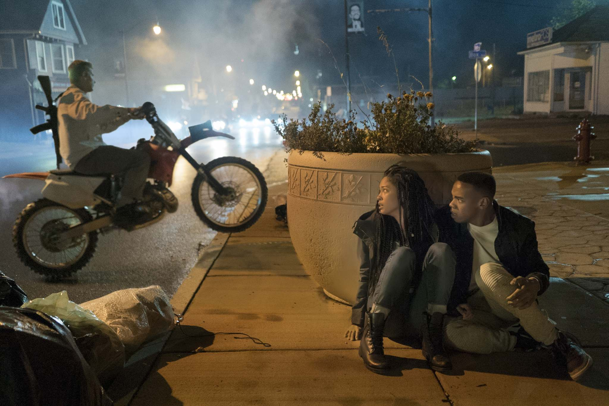 Nya (Lex Scott Davis) and Isaiah (Joivan Wade, right) seek some refuge from the mayhem. (Annette Brown / Universal Pictures)