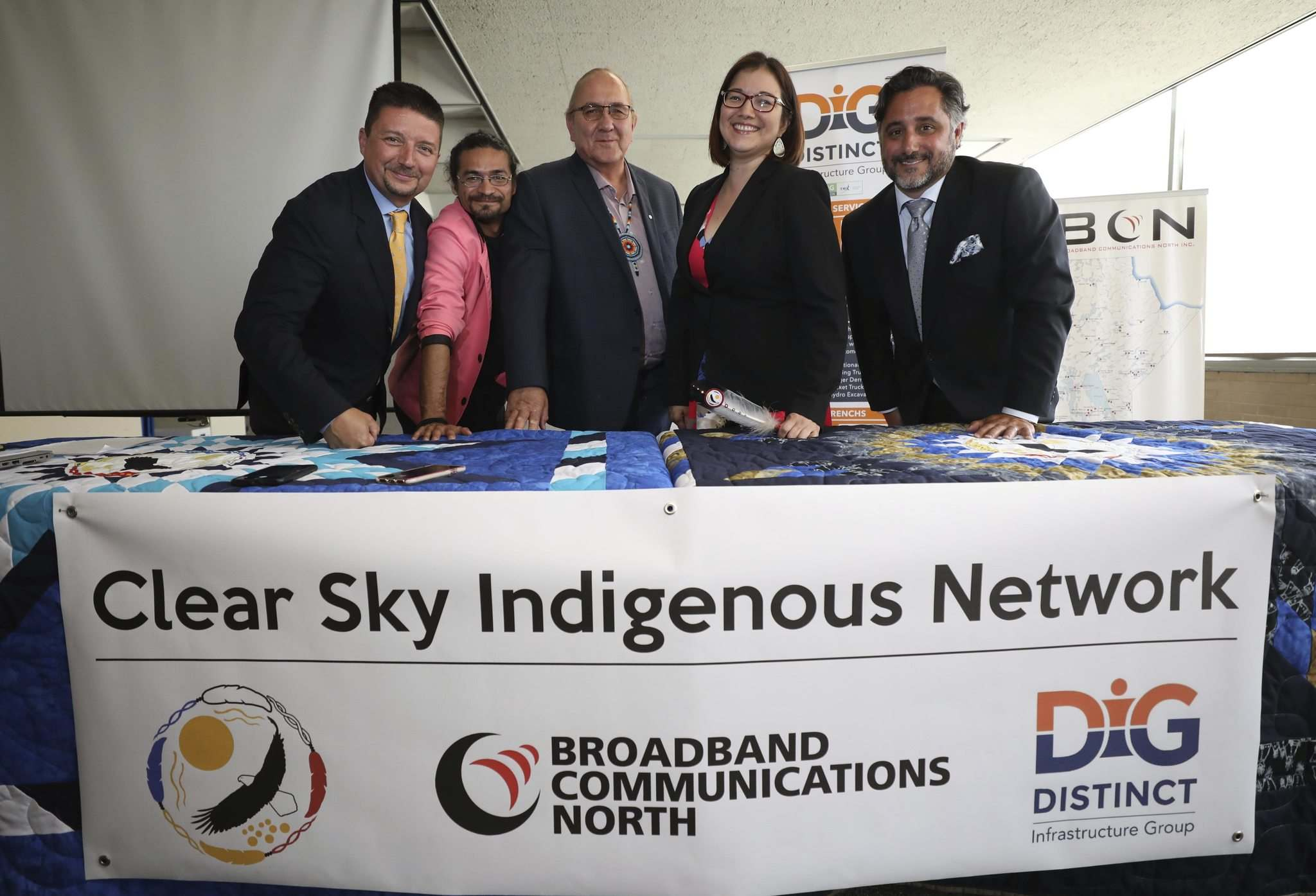 RUTH BONNEVILLE / WINNIPEG FREE PRESS</p><p>Alex Agius (from left) of Distinct Infrastructure Group (DIG), Ken Sanderson, executive director of Broadband Communications North, Clear Sky Connections board vice-president David Crate, Clear Sky CEO Lisa Clarke and Joe Lanni of DIG Inc. celebrate the announcement of a joint venture between three companies, which will bring high-speed internet to First Nations and surrounding communities across northern Manitoba.</p>