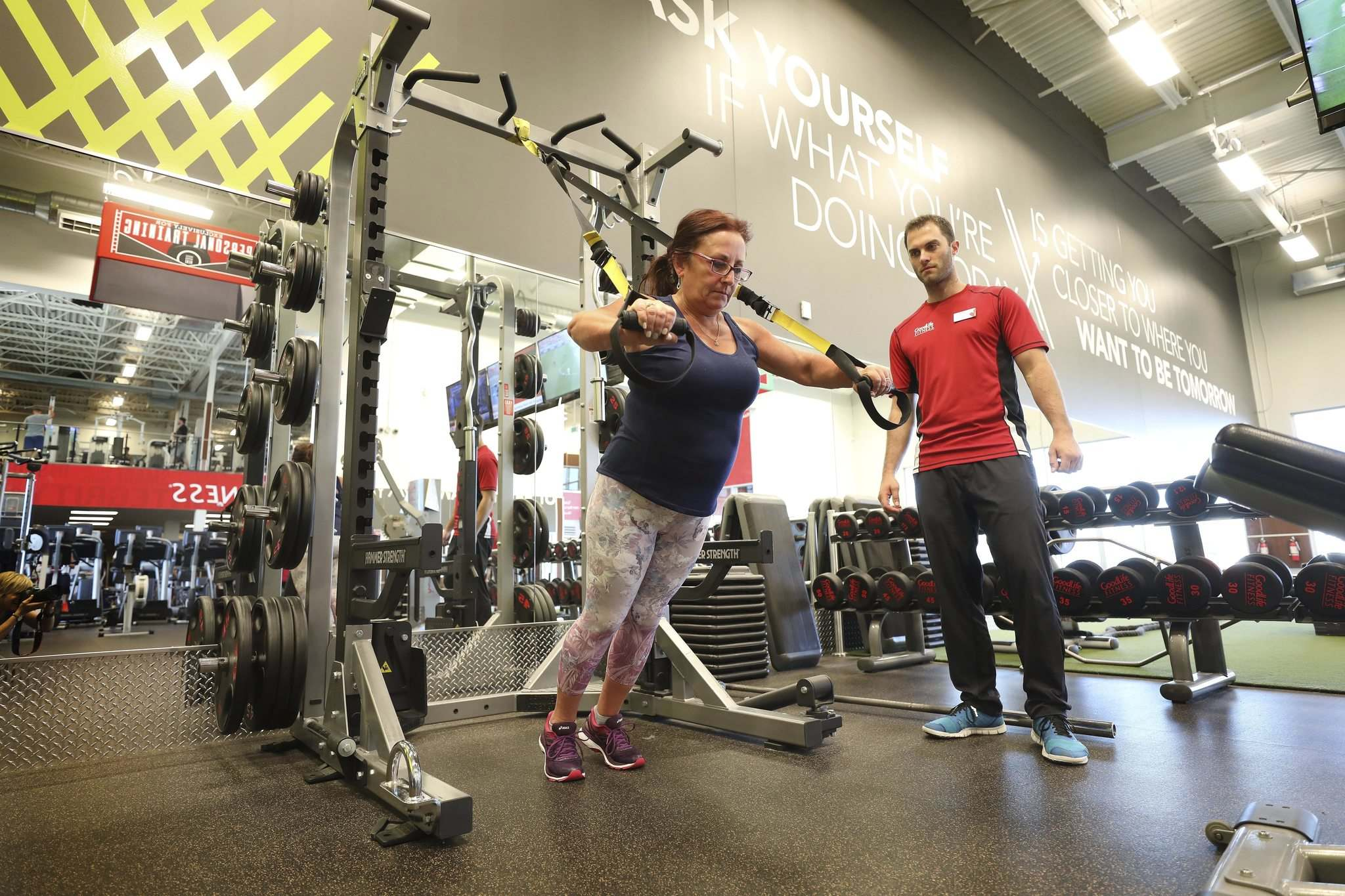 PHOTOS BY RUTH BONNEVILLE / WINNIPEG FREE PRESS</p><p>Carmen Yaeger works out at GoodLife Fitness Winnipeg Regent West with the help of Cameron Makarchuk, her personal trainer.</p>