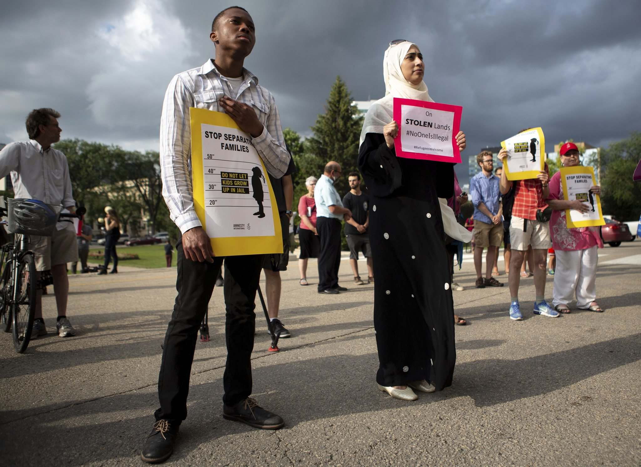 ANDREW RYAN / WINNIPEG FREE PRESS</p><p>Ugonna Chigbo (left) and Nosheen Umar stand together in front of the legislature on Wednesday at a protest against the U.S. policy of separating migrant children from their families.</p>