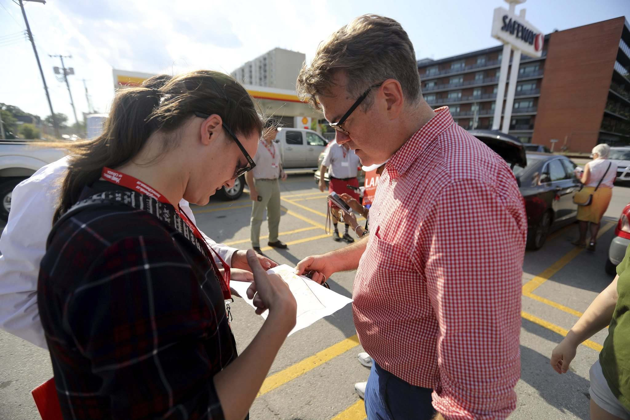 TREVOR HAGAN / WINNIPEG FREE PRESS</p><p>Caucus researcher Krista Bishop helps candidate Dougald Lamont on Thursday with his St. Boniface byelection campaign.</p>