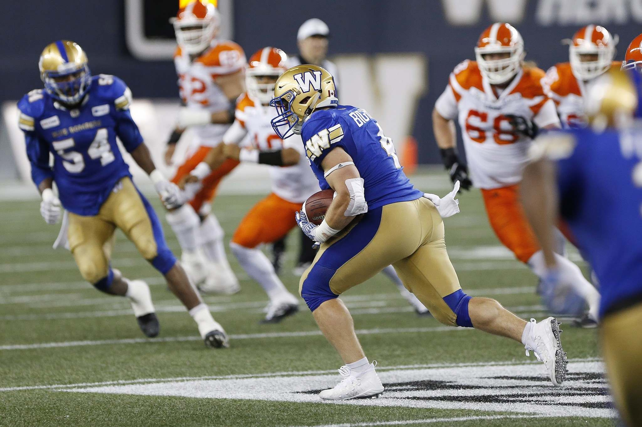 THE CANADIAN PRESS/John Woods</p><p>Winnipeg Blue Bombers&#39; Adam Bighill intercepts the BC Lions&#39; pass and runs it in for the touchdown during the second half of CFL action in Winnipeg Saturday. Bighill is having a homecoming of sorts when he returns to Vancouver to face the B.C. Lions for the first time as a member of the Bombers.</p>