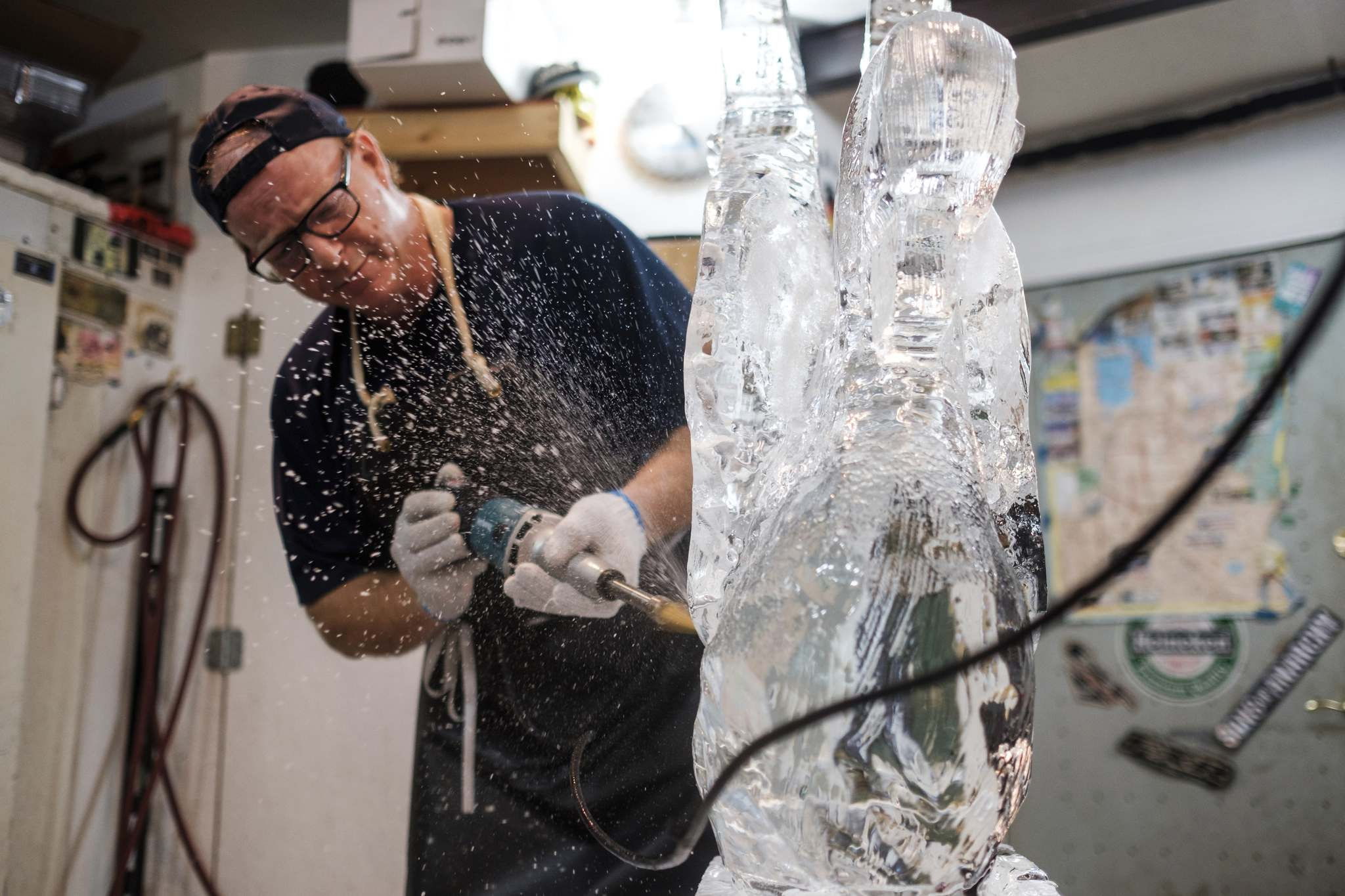 Wade hard at work carving a swan in his Winnipeg studio.