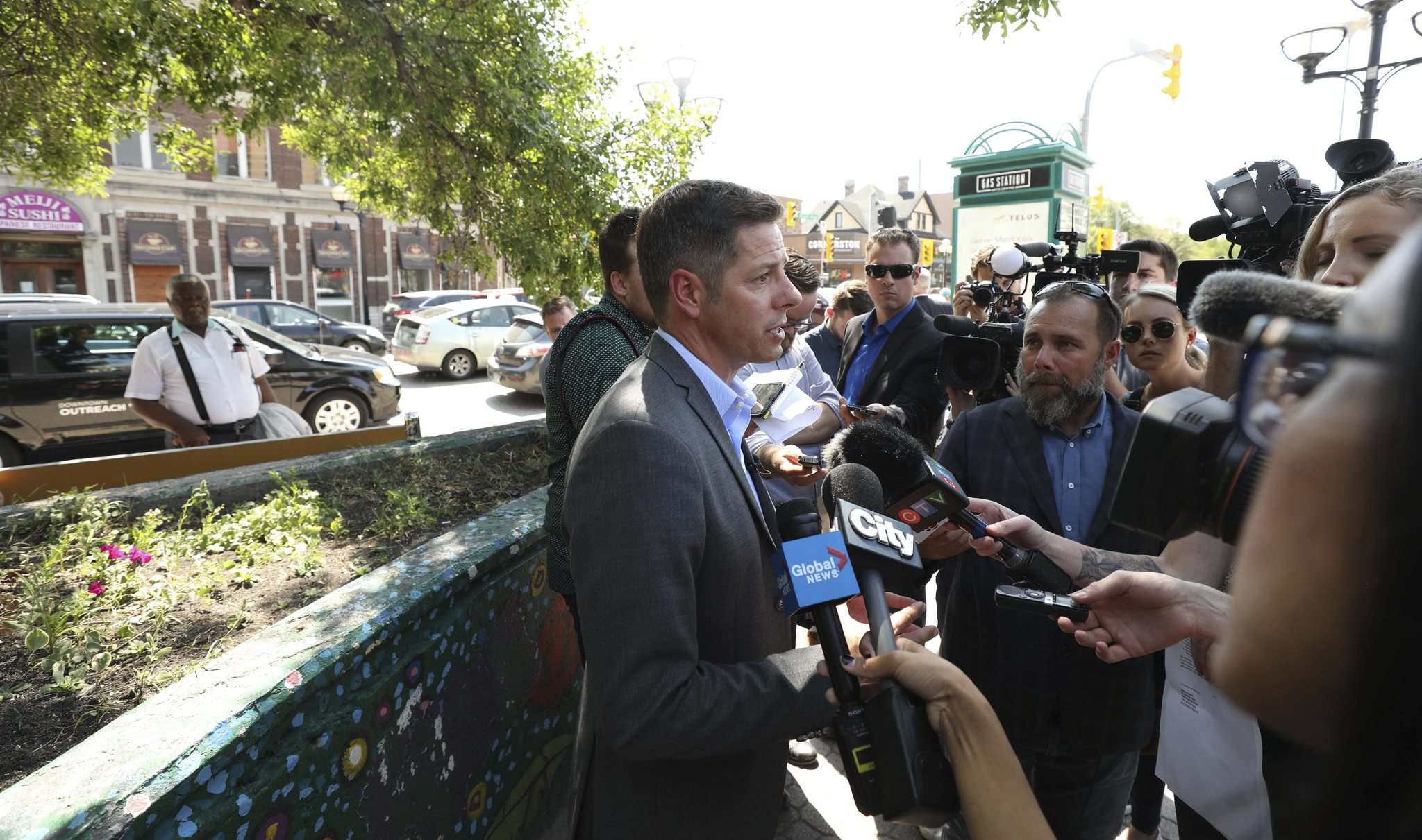 <p>Mayor Brian Bowman talks to the media in a scrum after presser was held at northeast corner of Osborne St and River about plans by the mayor along with representatives of key community organizations, to address and reduce the occurrence of unsafe panhandling Friday afternoon. </p>