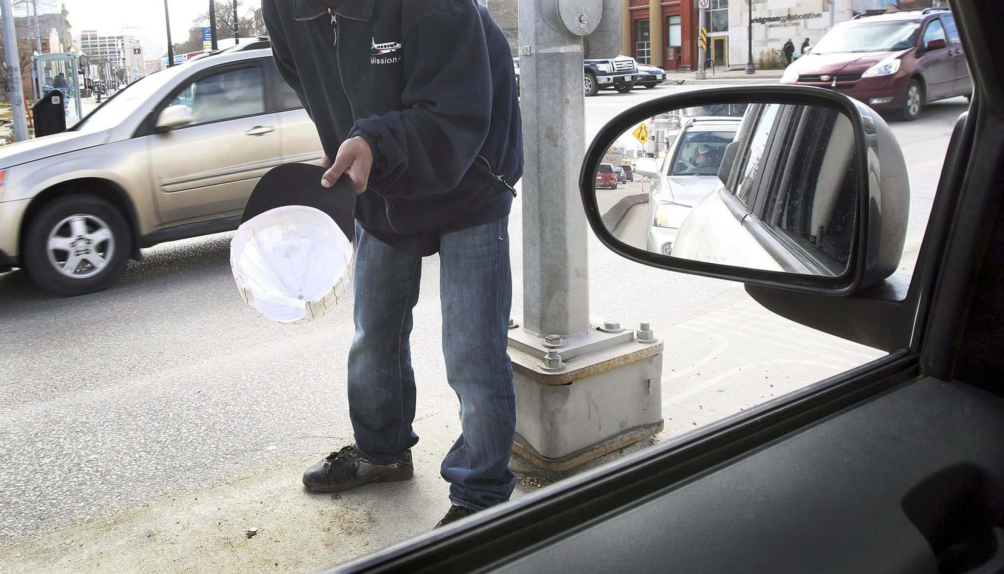 <p>Siloam Mission executive chief Jim Bell says panhandling on the street is unsafe, 'One little slip and one little fall and it could be tragic.'</p>