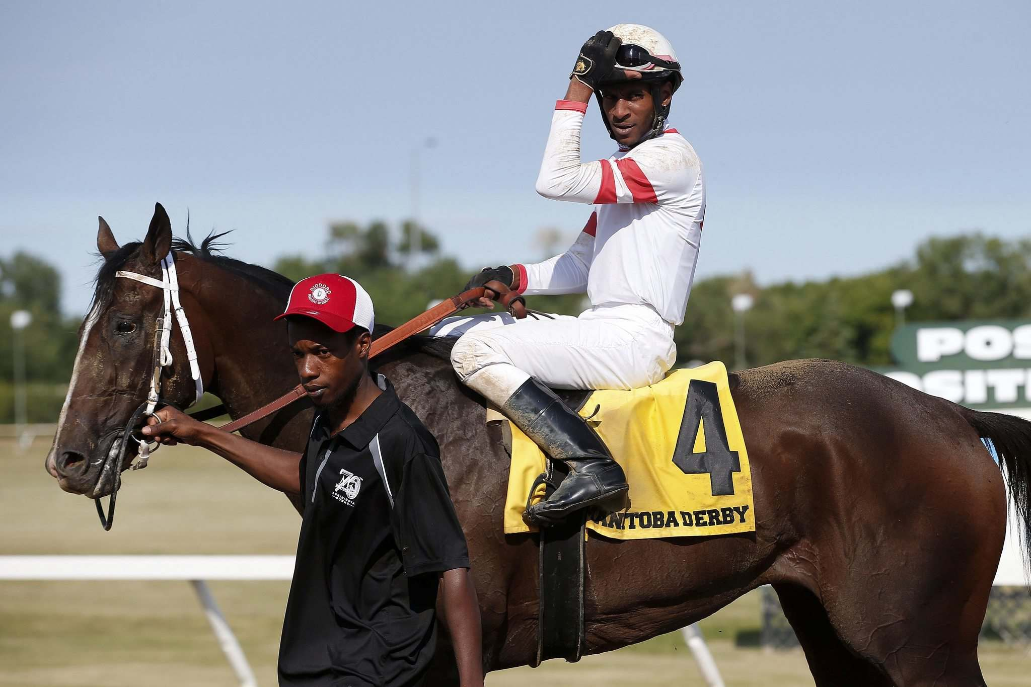 Rico Walcott riding Sky Promise wins the 70th running of the Manitoba Derby at Assiniboia Downs Monday. (John Woods / Winnipeg Free Press)</p>