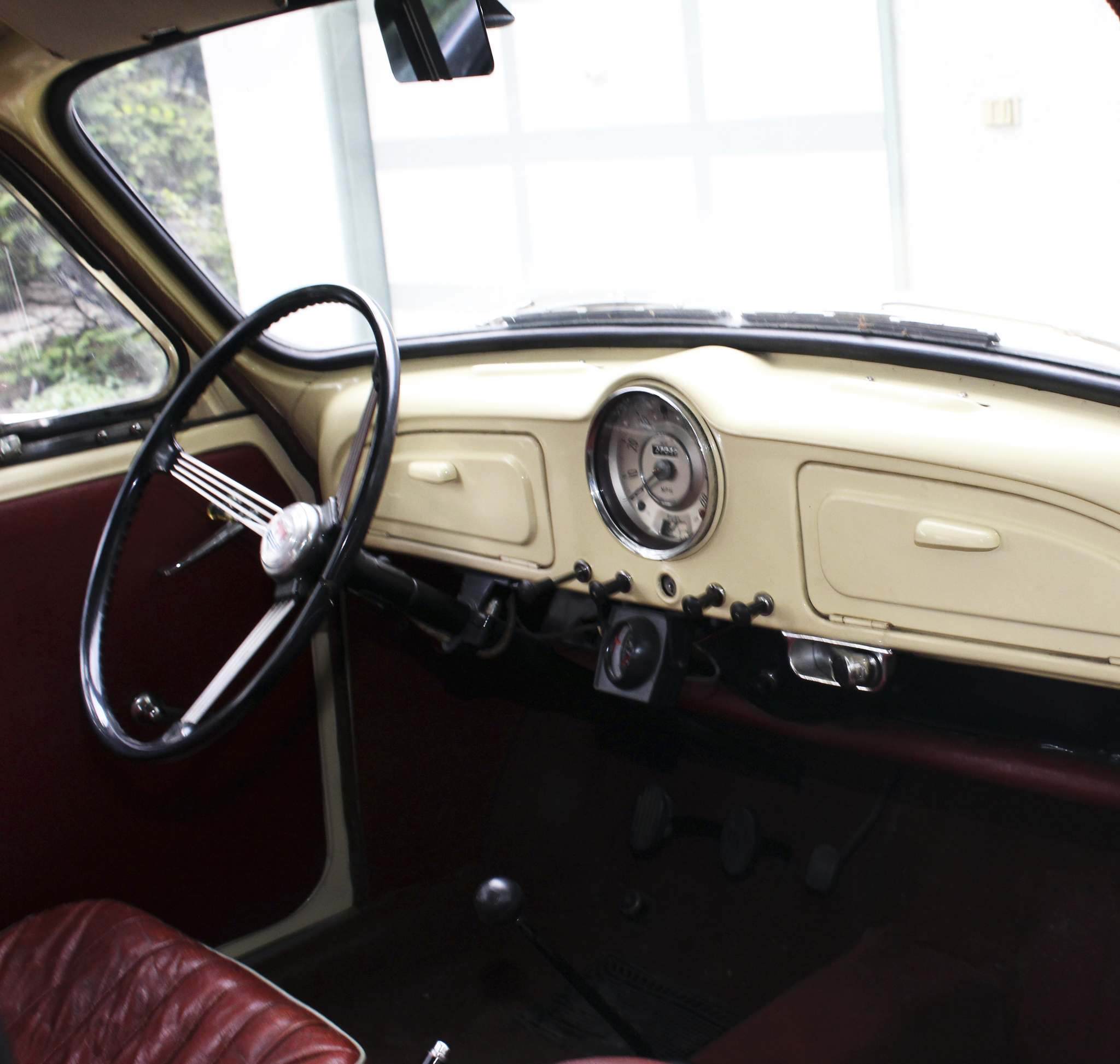 The Minor has a classic feel with red-leather bucket seats and a pull-start switch on the dash.