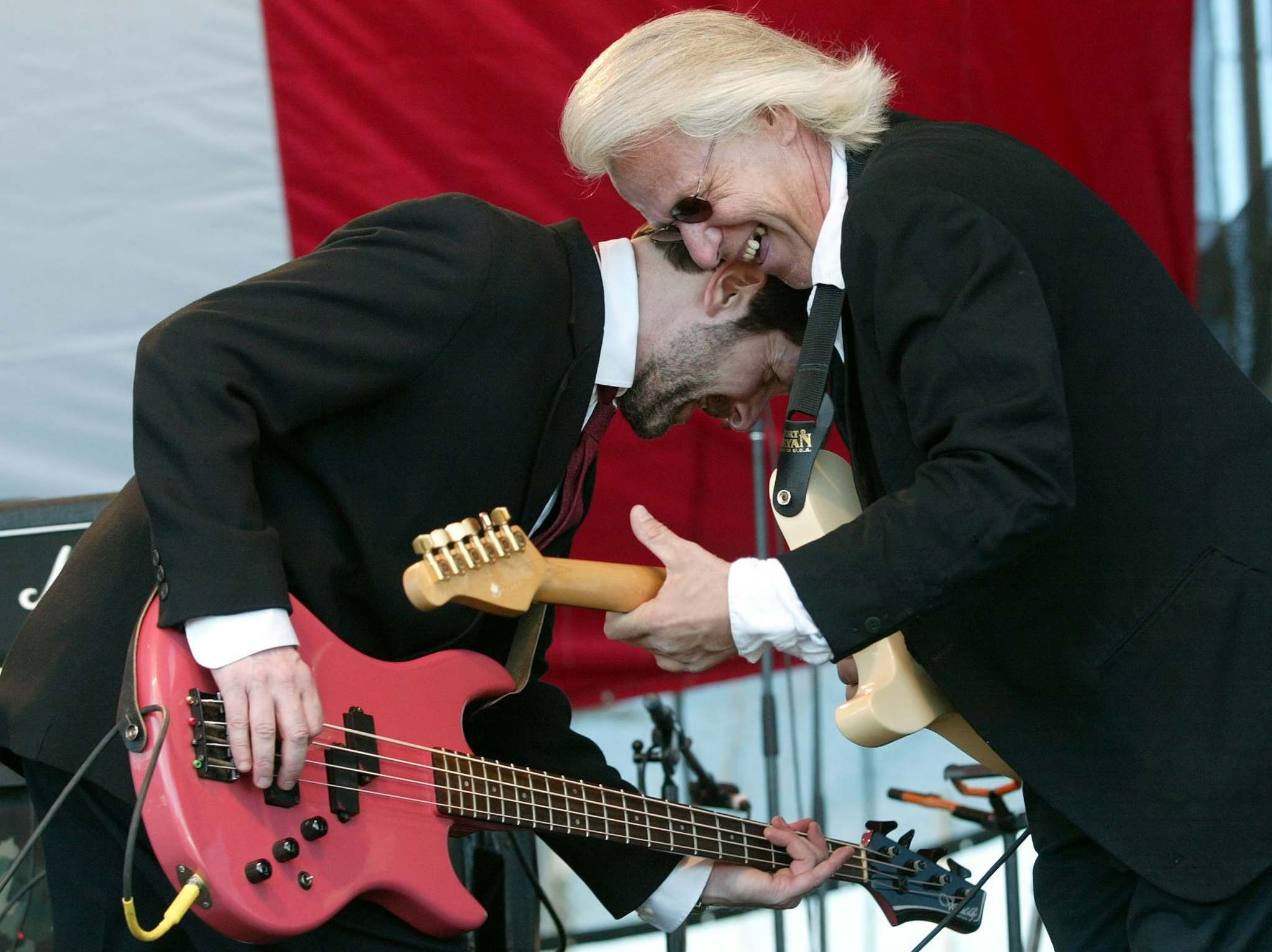 Chris Burke-Gaffney, left, and Lou Petrovich of Winnipeg's vintage rock group the Pumps rock on at Spiritfest at The Forks in May 2002.