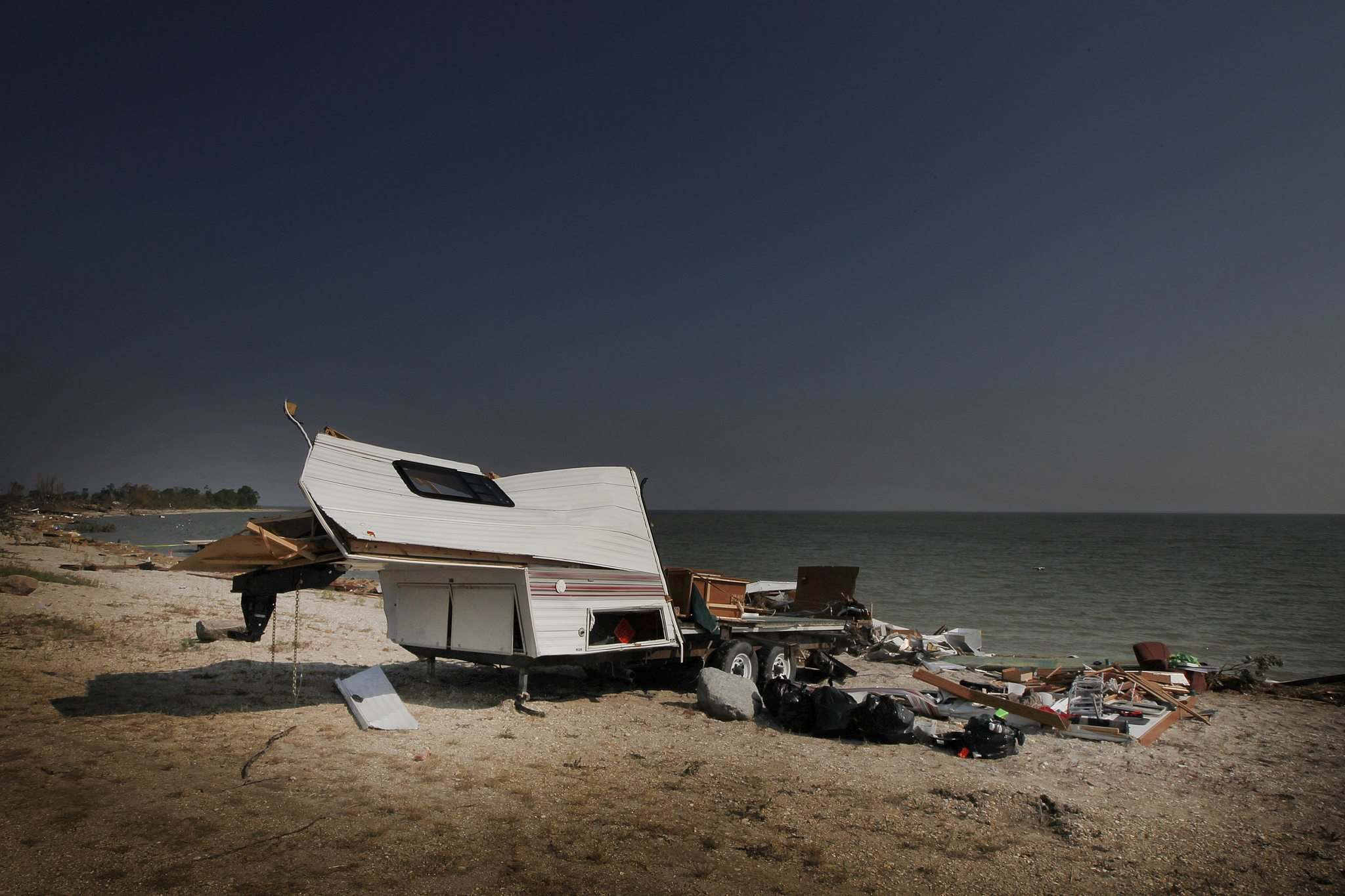 A trailer that was pulled from the water sits on the shore of Margaret Bruce Beach.</p>
