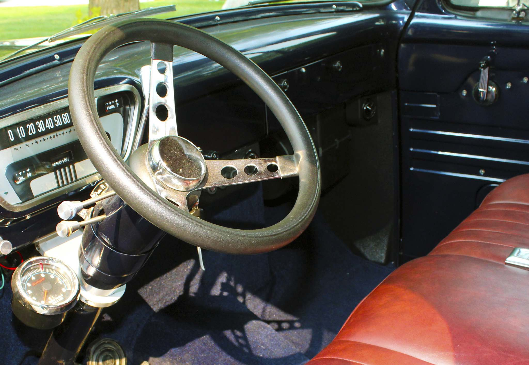 Inside the cab, the truck sports an Ididit tilt steering column and custom steering wheel.