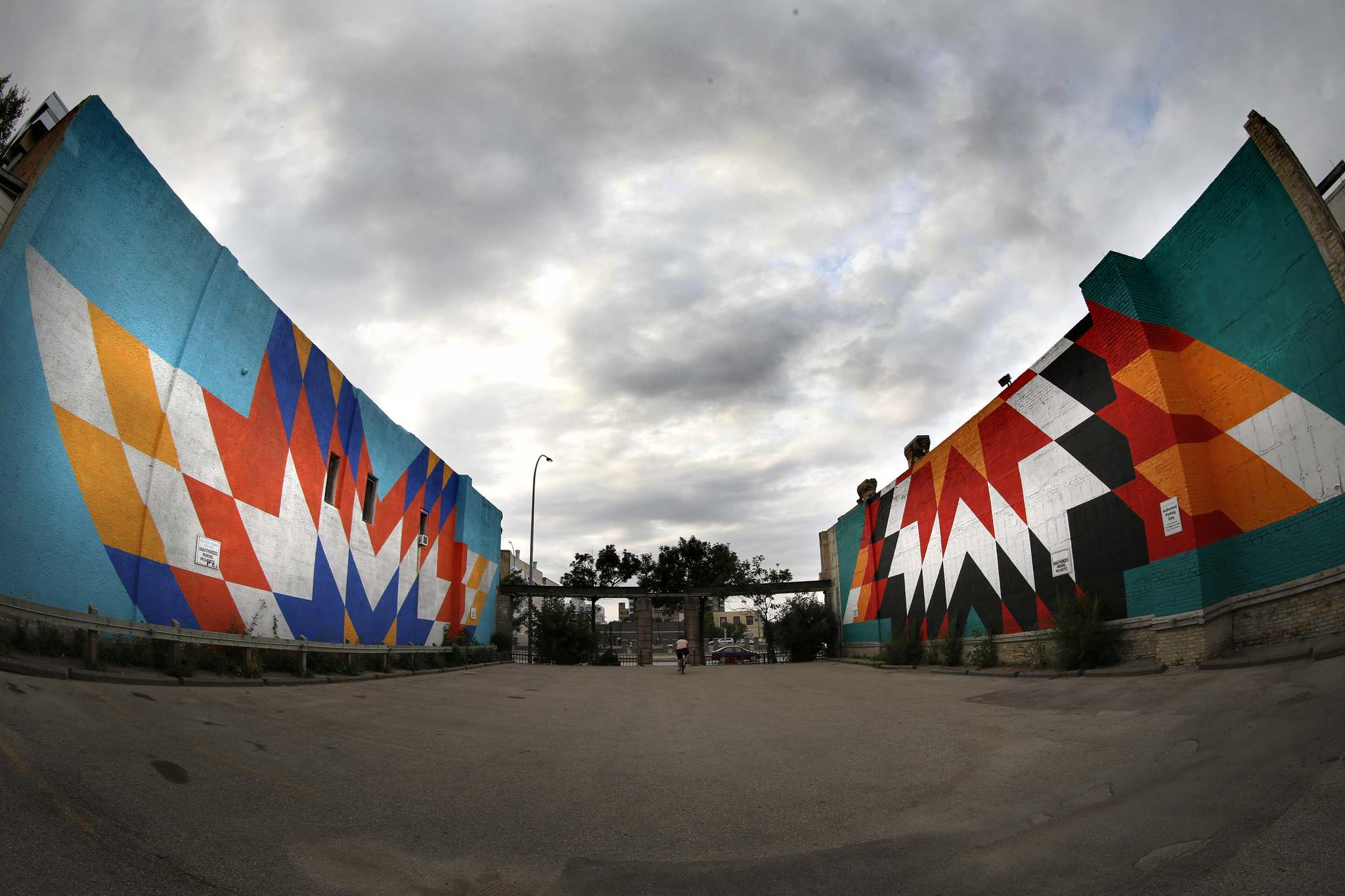 Kenneth Lavallee&#39;s mural on the Helen Betty Osborne Centre will be the fourth installation of his Star Blanket Project series, with sister sites located at Ma Mawi Wi Chi Itata Centre, the Edge Gallery (left) and the Red Road Lodge (right). (John Woods / Winnipeg Free Press Files)</p>