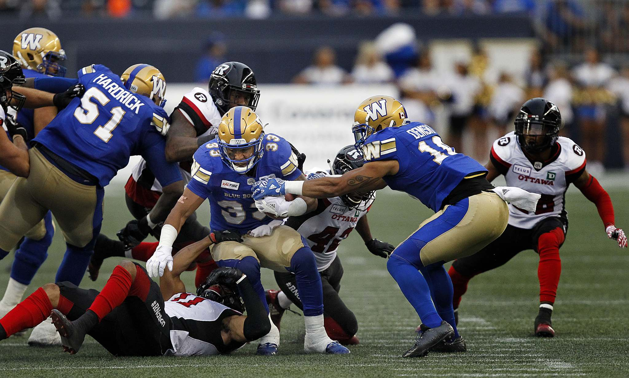 PHIL HOSSACK / WINNIPEG FREE PRESS -</p><p>Winnipeg Blue Bomber #33 Andrew Harris scrambles through the line of scrimmage.</p>