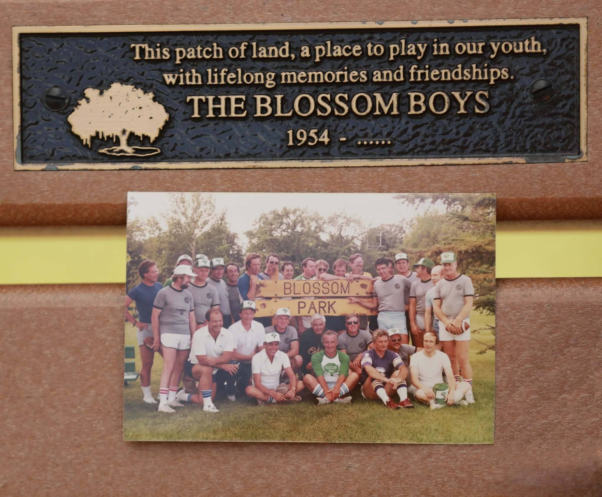 RUTH BONNEVILLE / WINNIPEG FREE PRESS</p><p>A photo of the Blossom Boys from the 1990s is seen on the bench that the group purchased for Andrew Currie Park.</p>