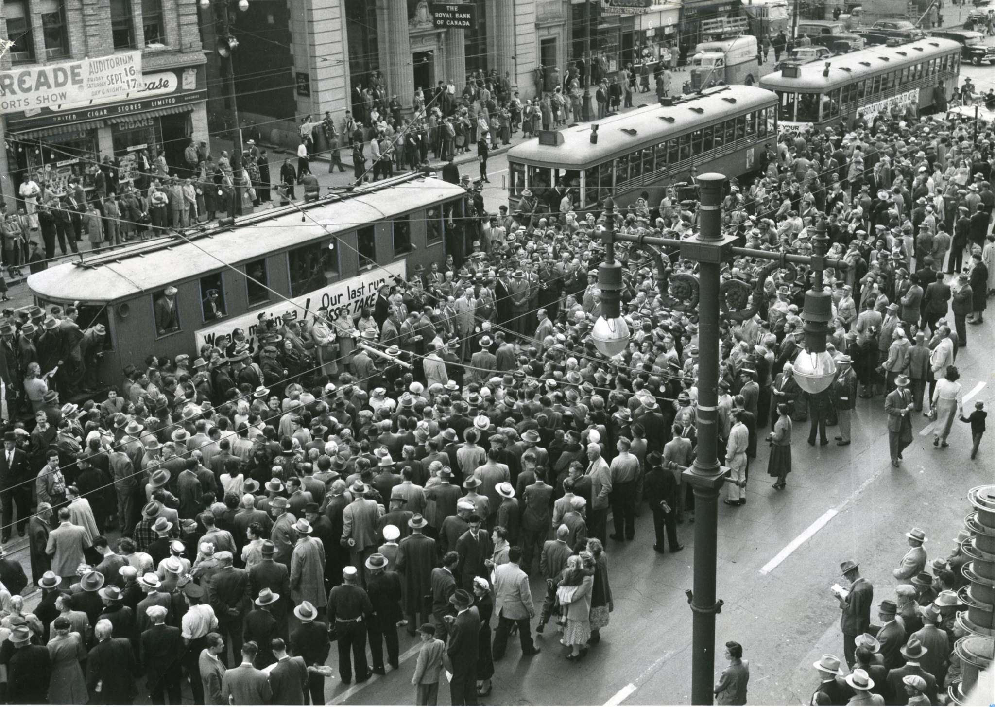 Hundreds of people jammed the street at Portage and Main to witness the final ceremony marking the end of streetcars in Winnipeg in September 1955. (Winnipeg Free Press Files)