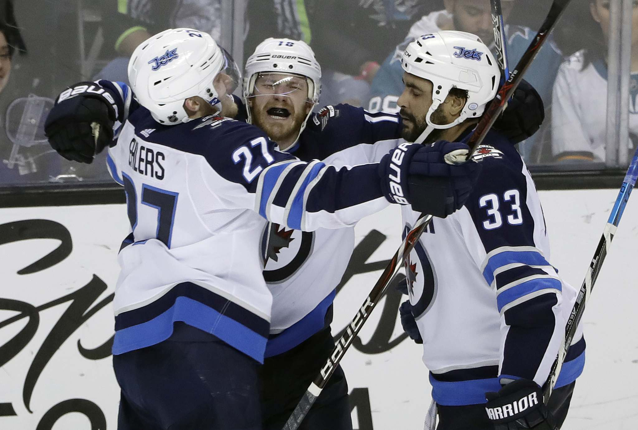 Winnipeg Jets' Bryan Little (centre) celebrates his overtime goal with teammates Nikolaj Ehlers (27) and Dustin Byfuglien (33) in an NHL hockey game against the San Jose Sharks last season in San Jose, Calif. Winnipeg won 5-4. (Marcio Jose Sanchez / The Associated Press)
