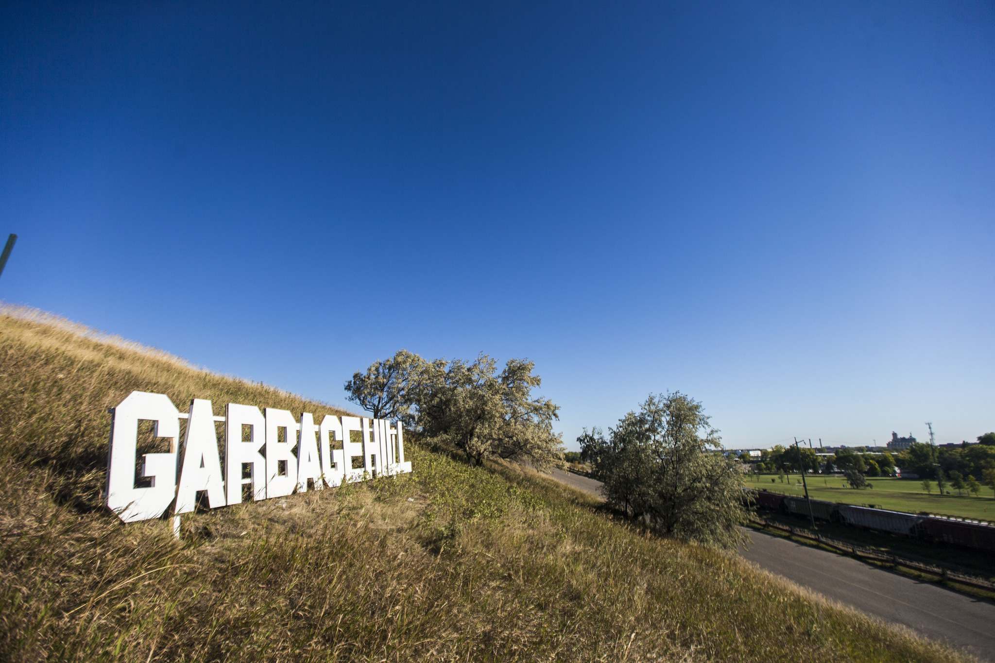 A Hollywood-esque sign on Garbage Hill was taken down by the city Monday hours after it appeared. (Mikaela Mackenzie / Winnipeg Free Press)</p>