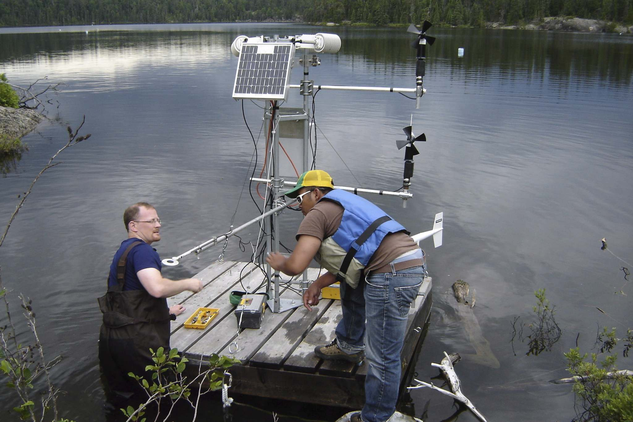 THE CANADIAN PRESS</p><p>Scientists set-up a raft with one of a series of micro-meterological stations on a lake at an experimental lakes research area in the northwestern Ontario.</p>