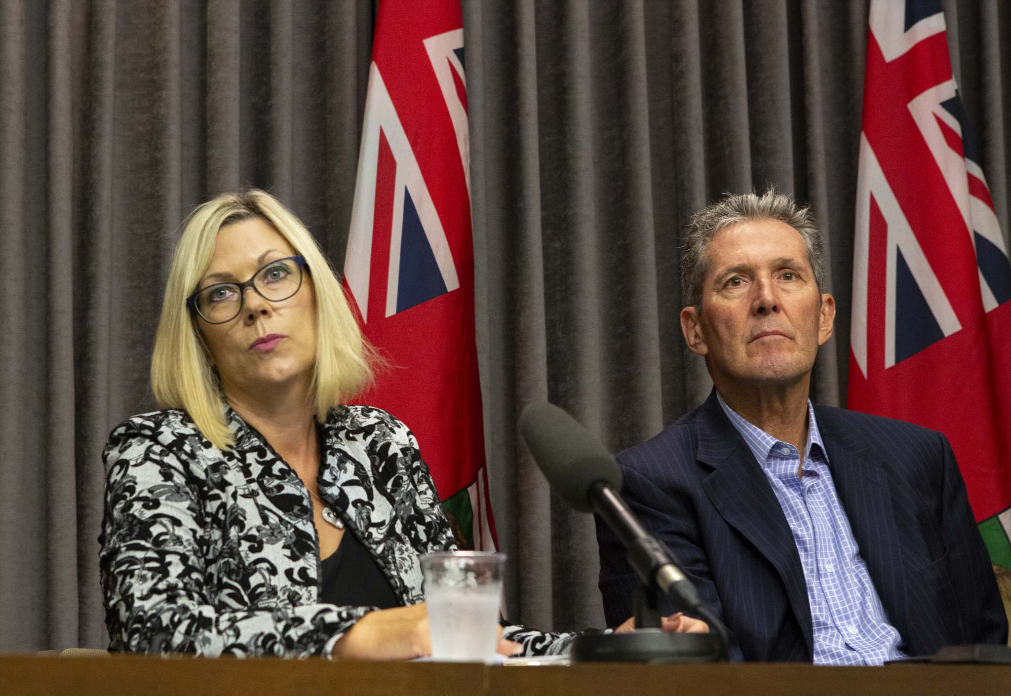 ANDREW RYAN / WINNIPEG FREE PRESS FILES</p><p>Sustainable Development Minister Rochelle Squires, left, and Manitoba Premier Brian Pallister have refuted the notion the government delayed the release of the bombshell CEC report.</p>