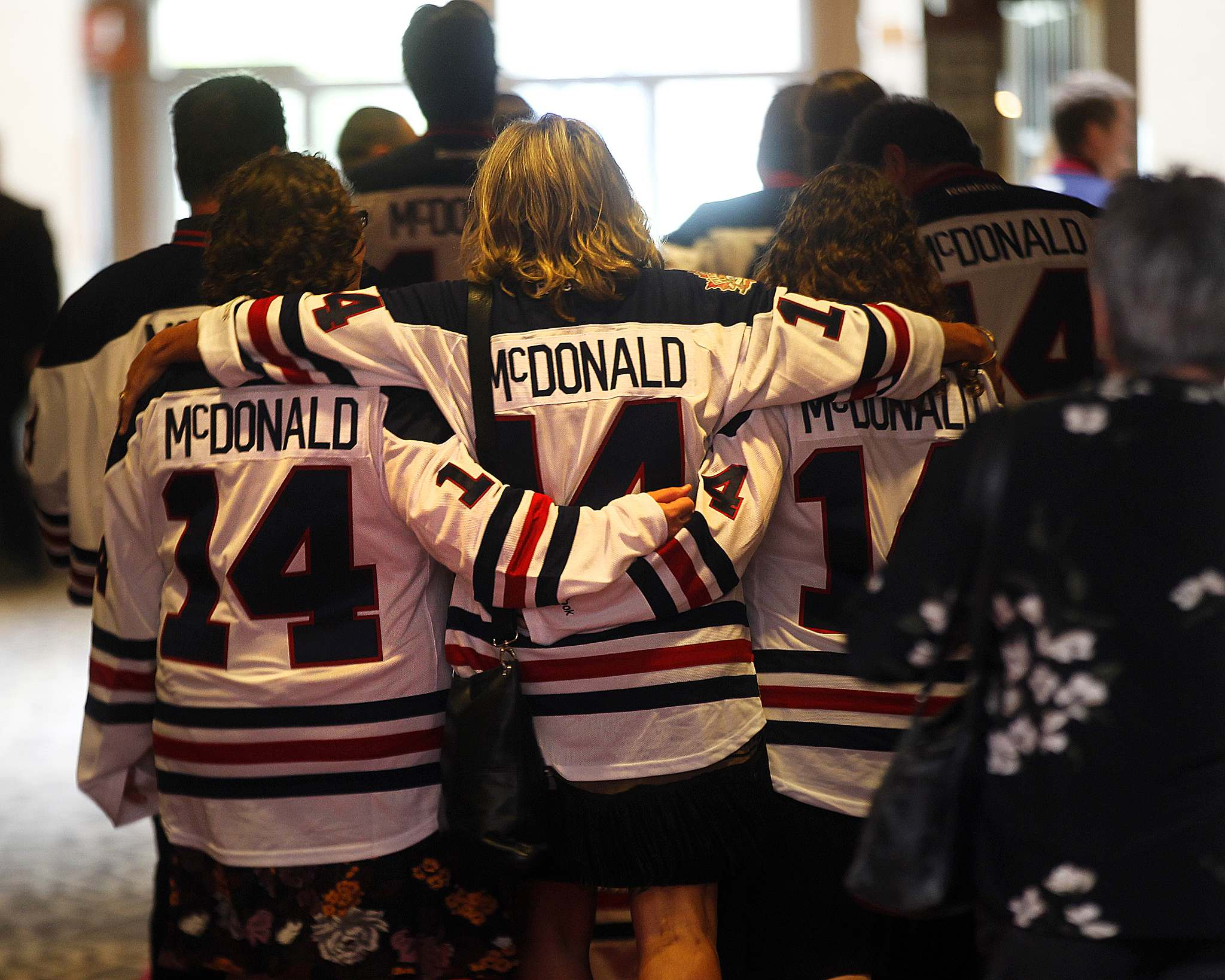 PHIL HOSSACK / WINNIPEG FREE PRESS</p><p>McDonald's family, wearing Winnipeg Jets Jerseys with his name on the back, leave the memorial celebration.</p>