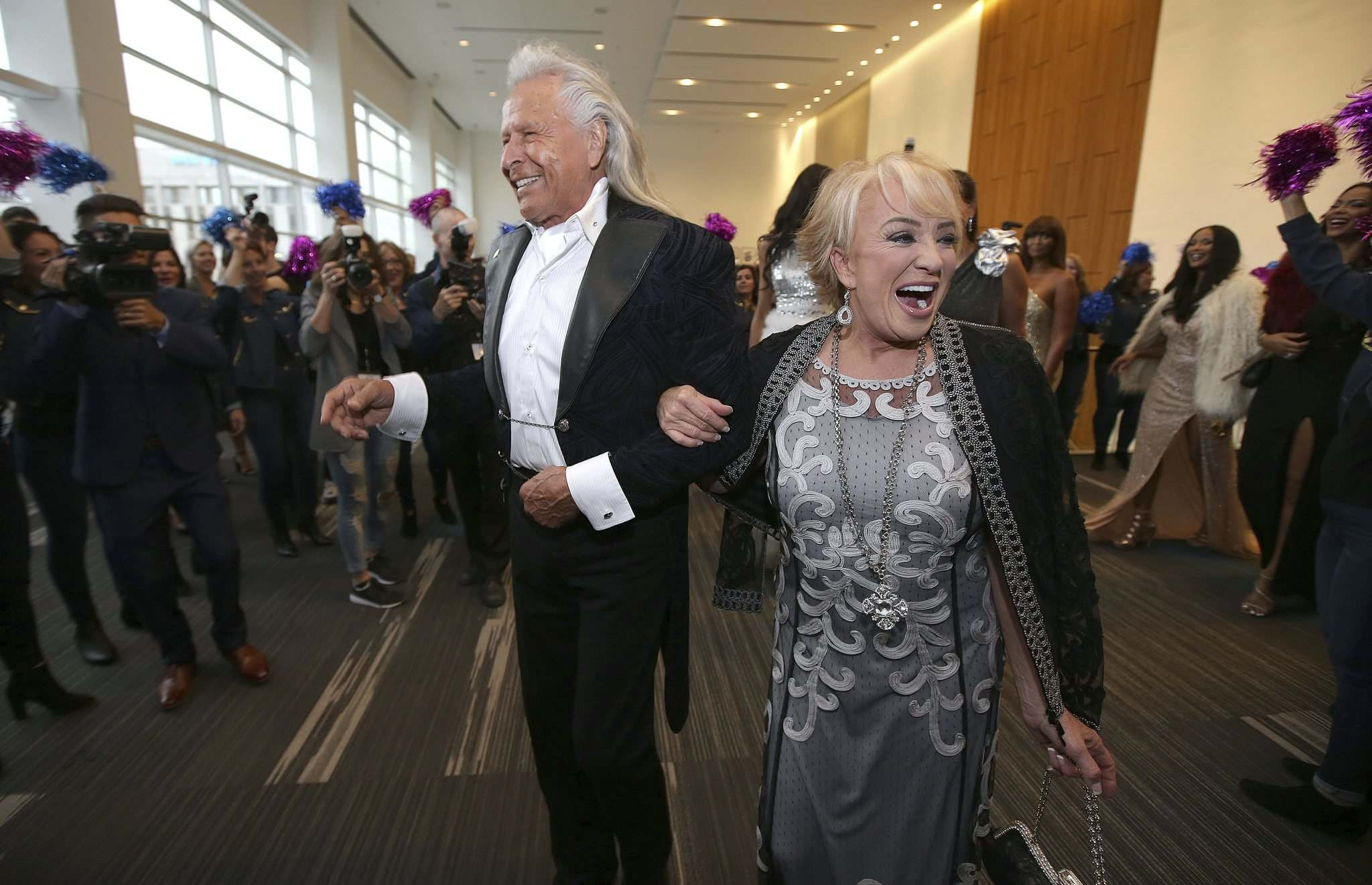 JASON HALSTEAD / WINNIPEG FREE PRESS</p><p>Peter Nygard and country singer Tanya Tucker arrive at the Nygard 50 Years in Fashion gala at the RBC Convention Centre Friday.</p>