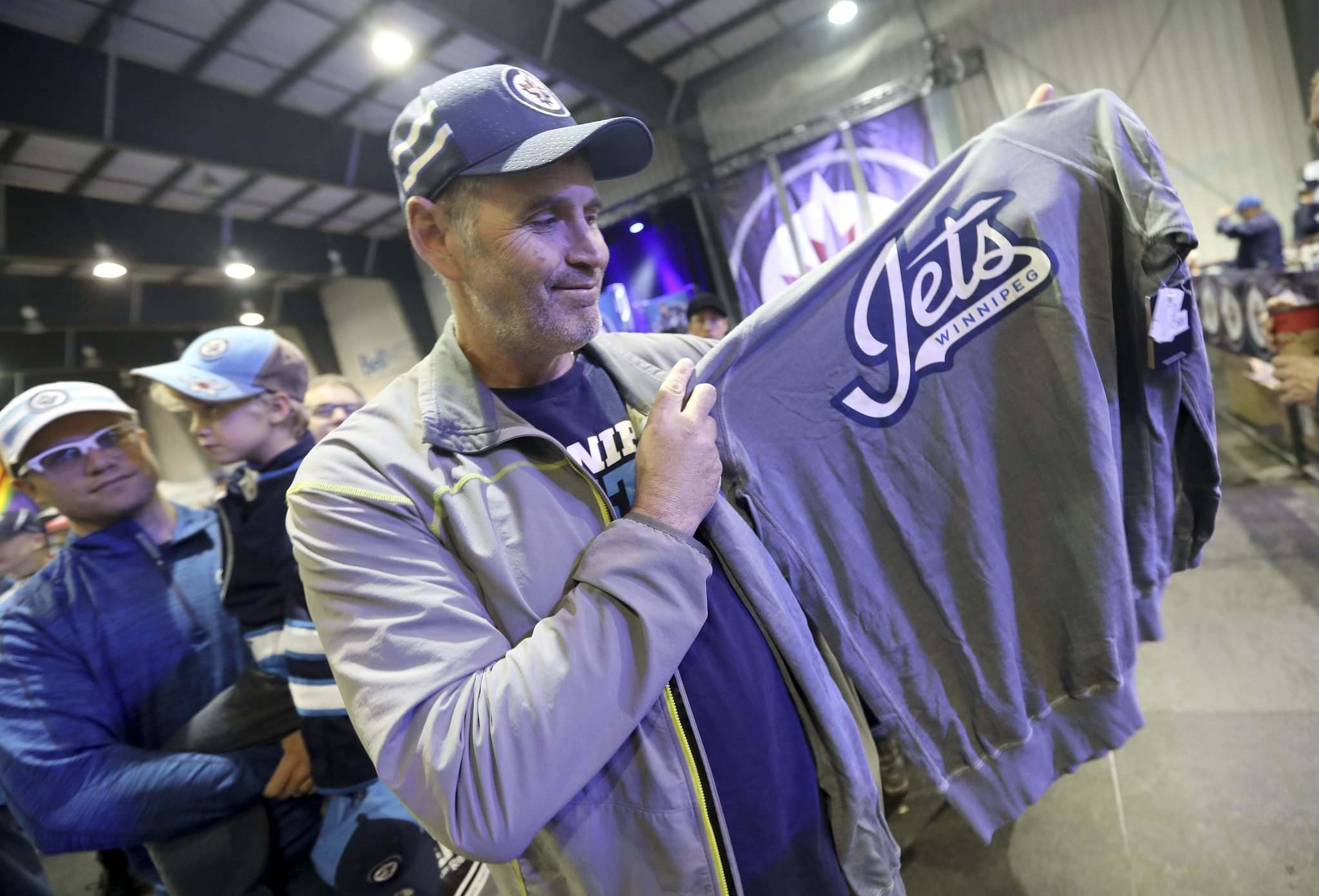 Shawn McCartney picks out some merchandise.
