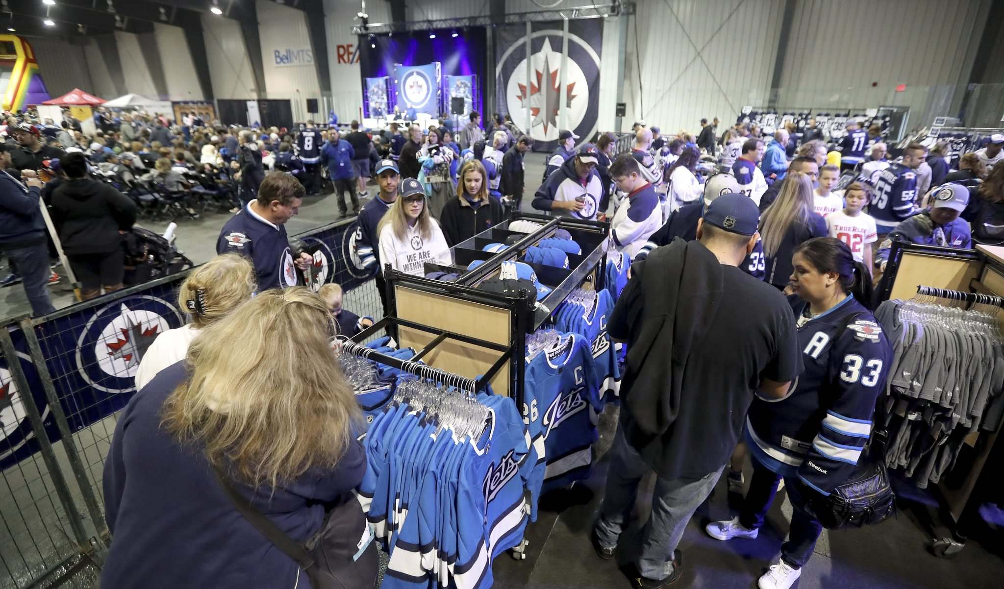 Jets' fans shop for merchandise this morning at Fan Fest.