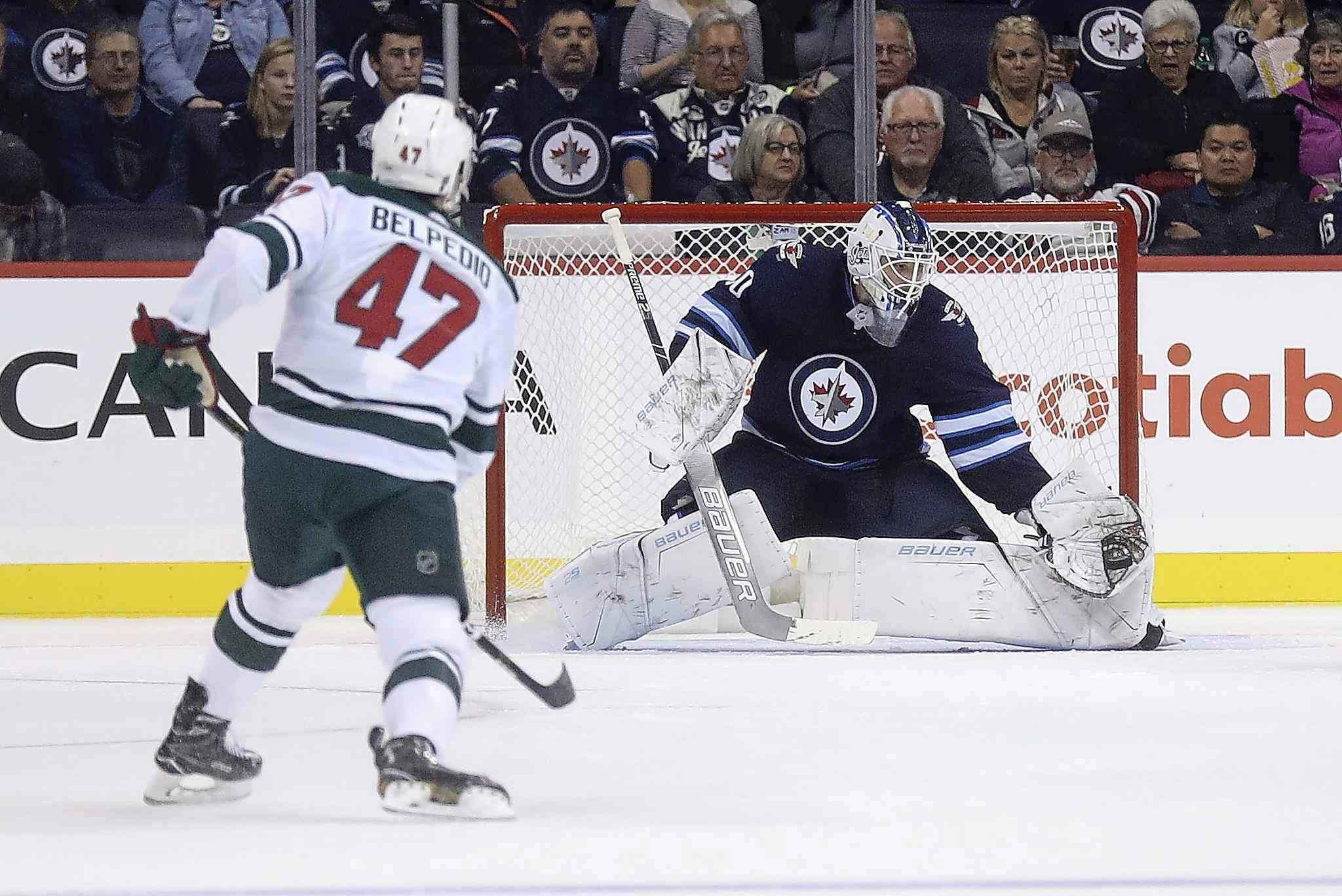 <p>Winnipeg Jets goaltender Laurent Brossoit stops a shot by the Minnesota Wild's Louie Belpedio during second period preseason NHL hockey in Winnipeg, Monday. Brossoit made 39 saves in the Jets 2-1 victory.</p>