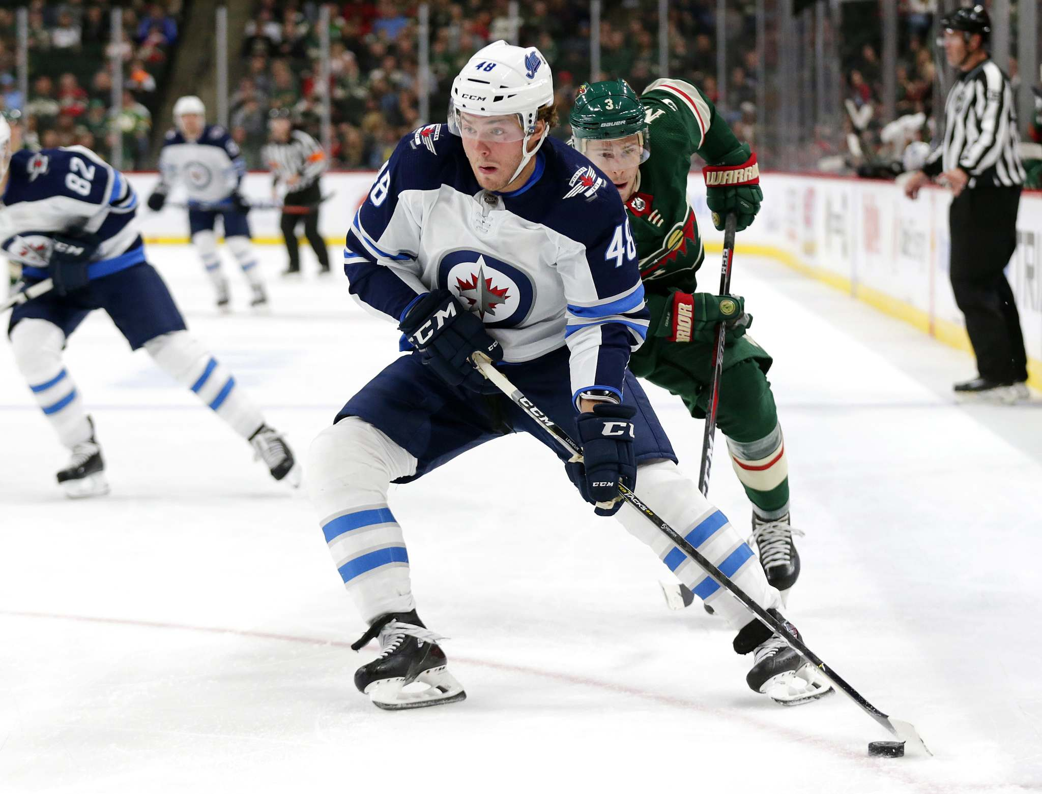 AP Photo/Andy Clayton-King</p><p>Winnipeg Jets left wing Brendan Lemieux controls the puck in front of Minnesota Wild right wing Charlie Coyle during the first period of a preseason NHL hockey game Wednesday in St. Paul, Minn. </p>