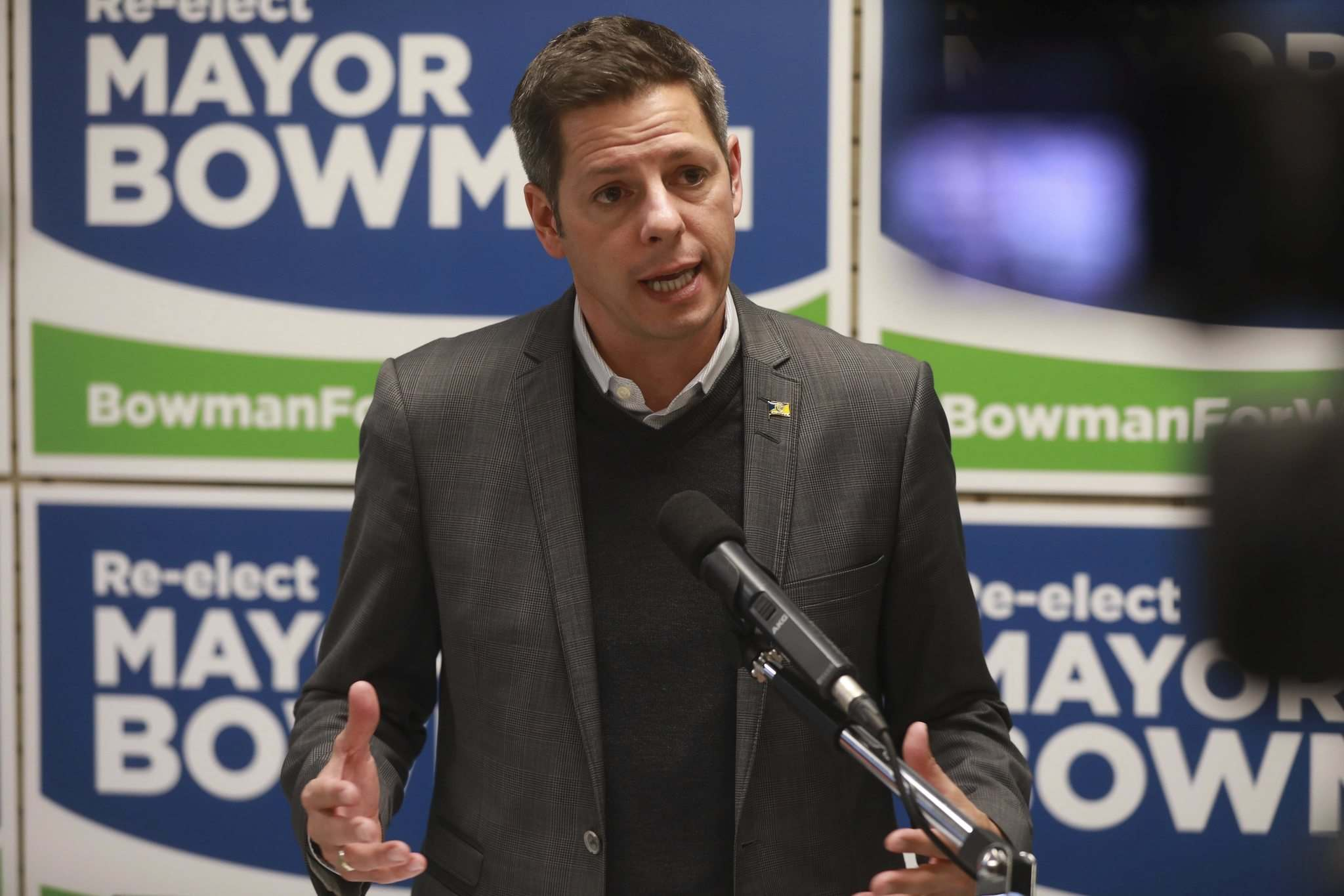 RUTH BONNEVILLE / WINNIPEG FREE PRESS</p><p>Mayor Brian Bowman has committed to exploring a 24-7 policy for road work.</p><p>Right: Umar Hayat answers a question during Thursday's mayoral forum in the theatre at the Centre culturel franco-manitobain.</p>