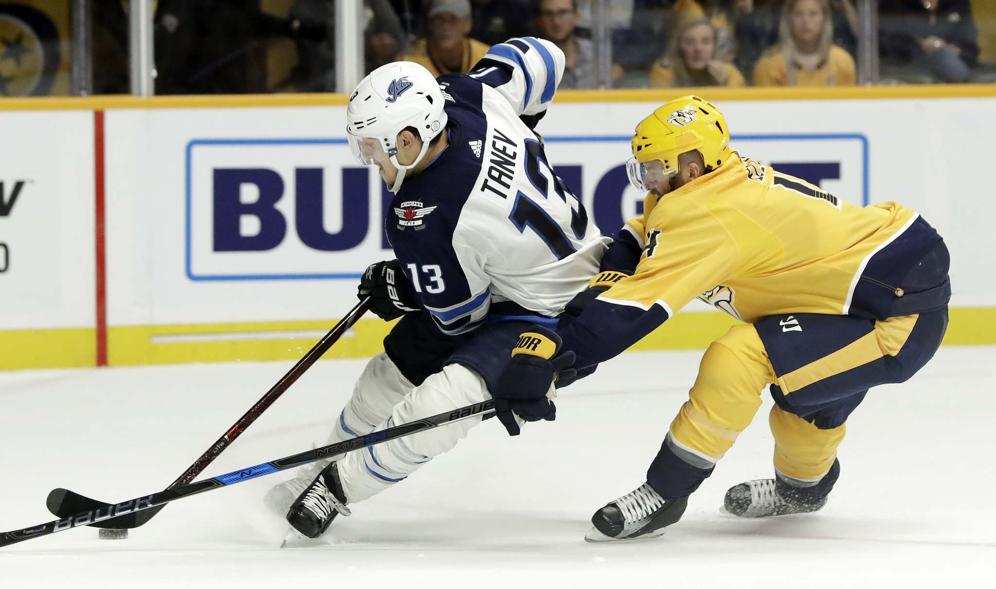 Brandon Tanev moves the puck ahead of defenceman Ryan Ellis in the first period in Nashville, Tenn. last night. (Mark Humphrey / The Associated Press)</p></p>