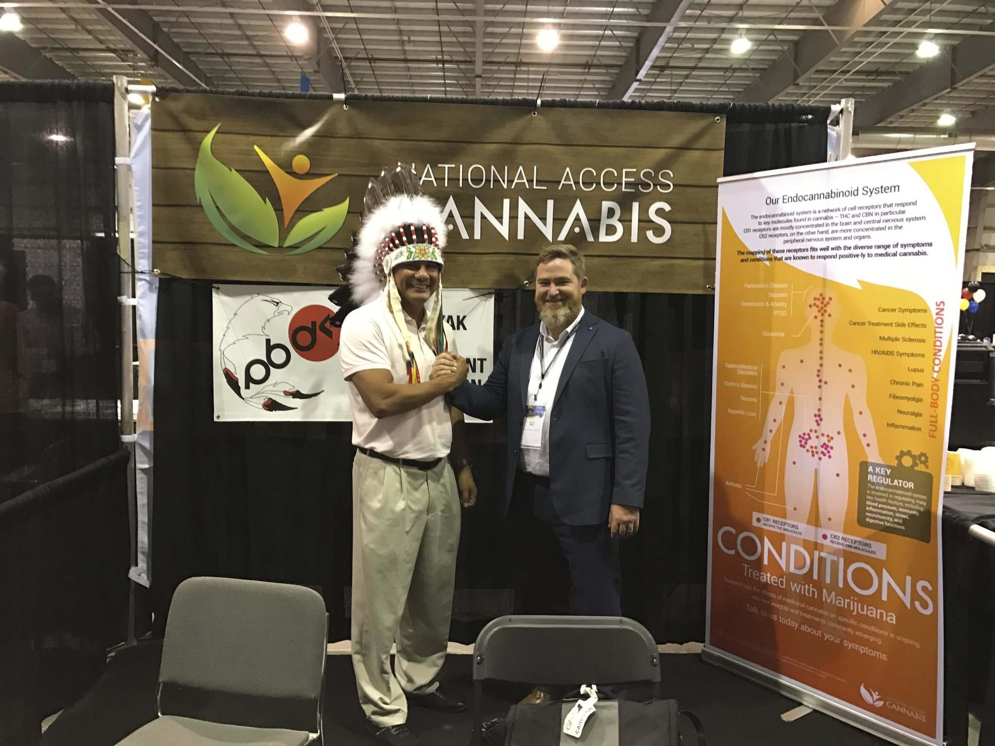 SUPPLIED</p><p>OCN Chief Christian Sinclair poses with Chuck Rifici, chairman of National Access Cannabis, last year.</p>