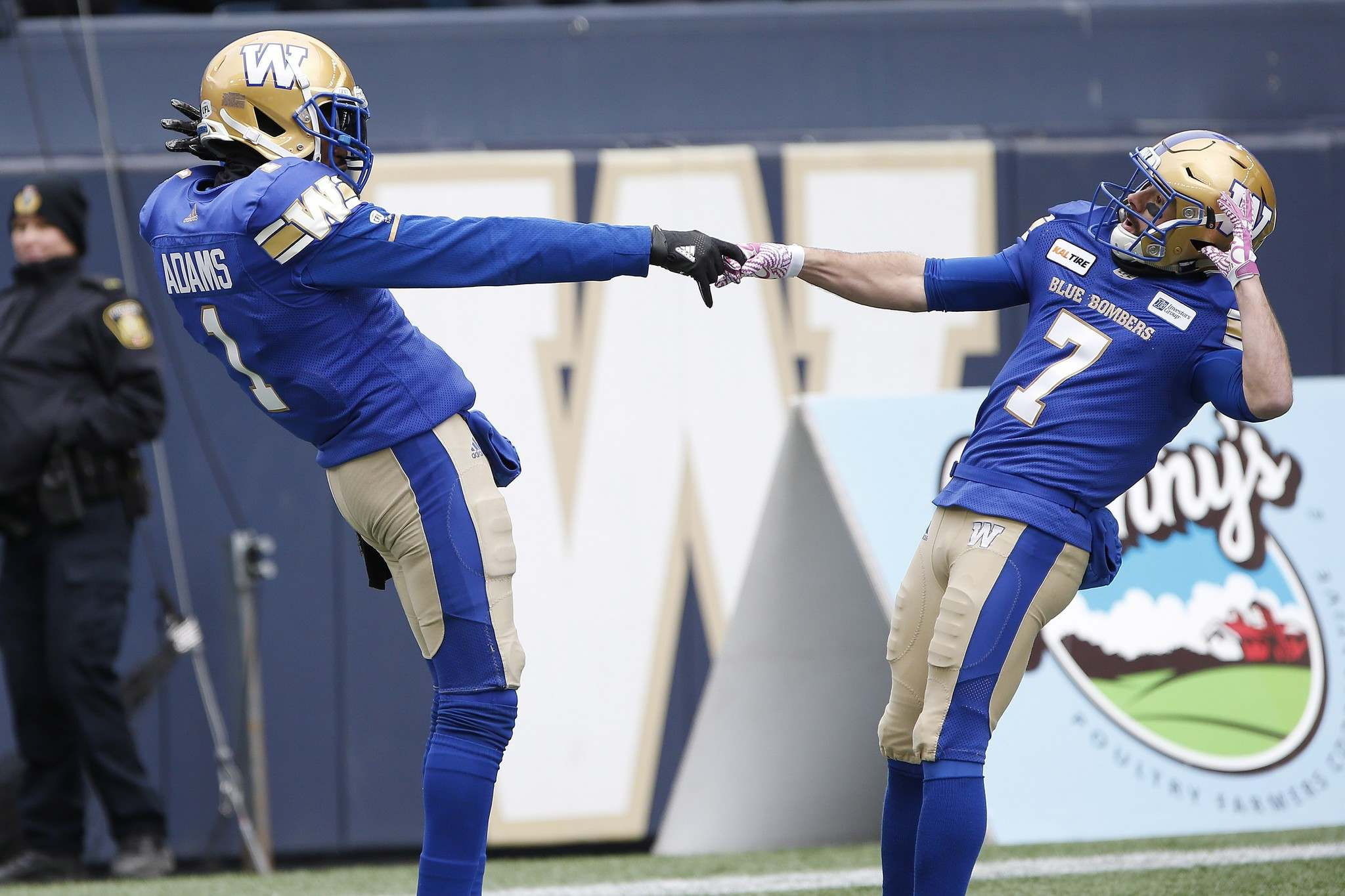 JOHN WOODS / THE CANADIAN PRESS</p><p>Darvin Adams and Weston Dressler celebrate Adams&#39; touchdown against the Saskatchewan Roughriders during the first half.</p>