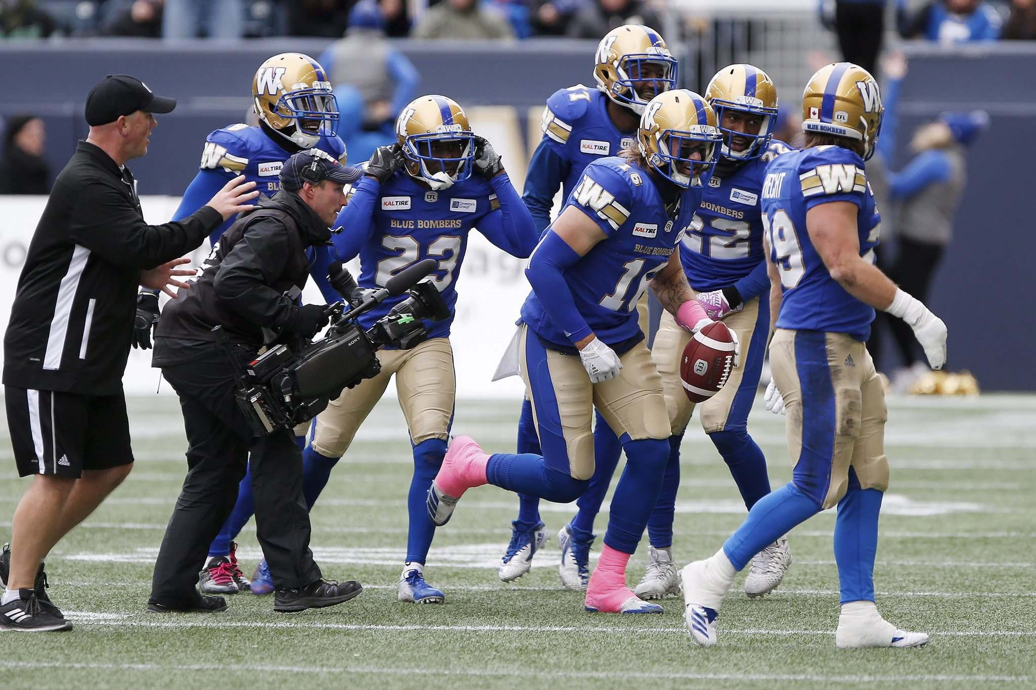 JOHN WOODS / THE CANADIAN PRESS</p><p>The Blue Bombers celebrates Taylor Loffler&#39;s interception during Saturday&#39;s game against the Roughriders.</p>