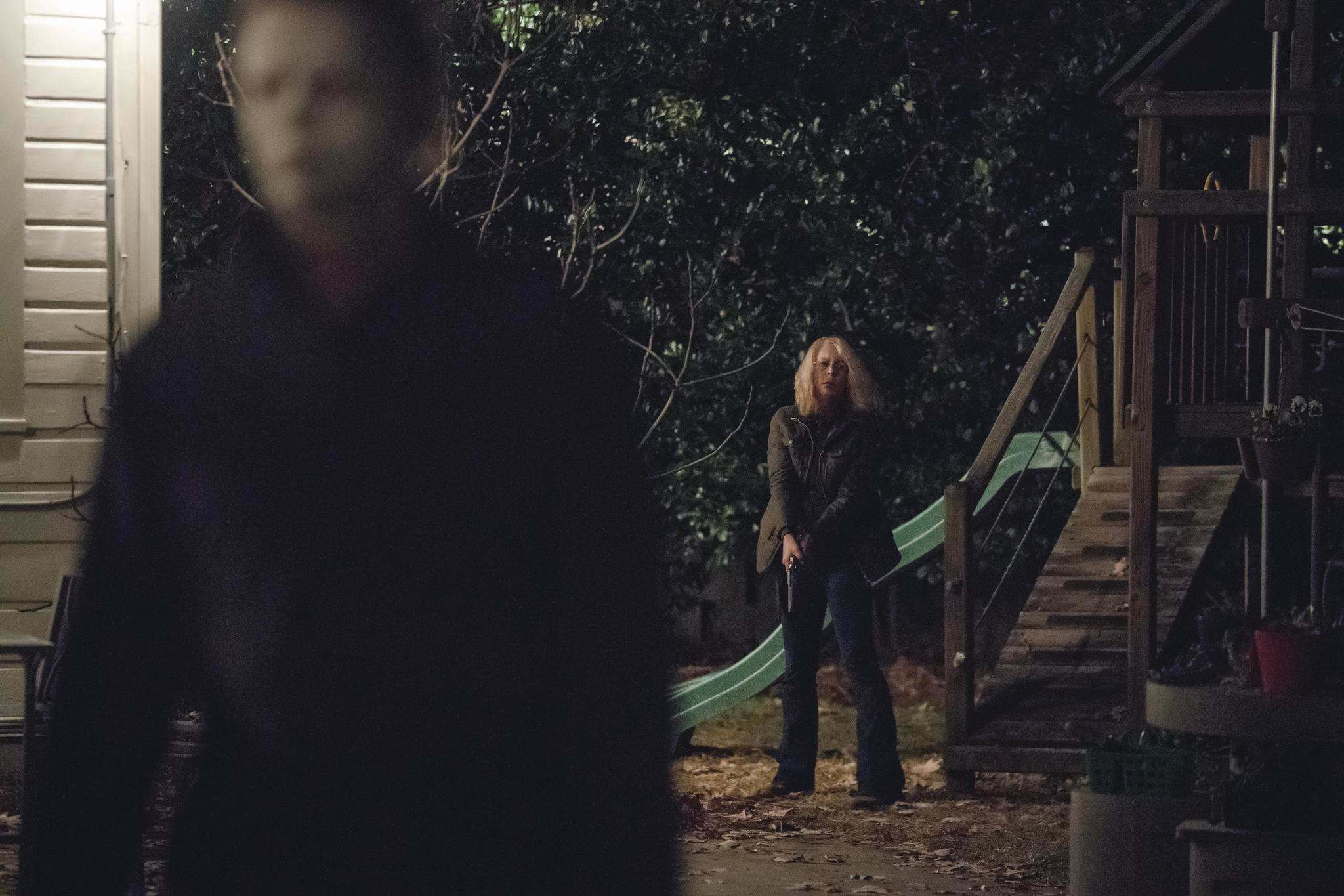 Laurie Strode (Jamie Lee Curtis) prepares to confront Michael Myers (Jim Courtney) in Halloween.