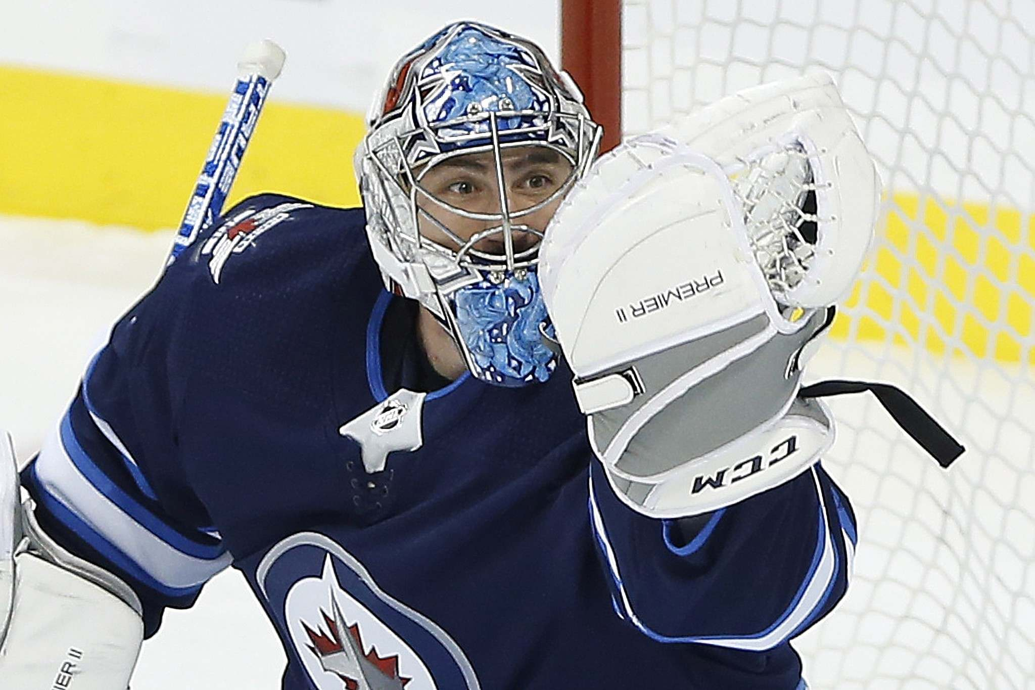 John Woods / The Canadian Press</p><p>Winnipeg Jets goaltender Connor Hellebuyck keeps his eye on the puck as he makes a save.</p>