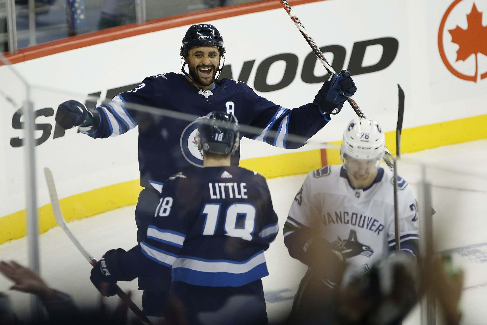 Winnipeg Jets' Dustin Byfuglien (33) and Bryan Little (18) celebrate Byfuglien's goal against the Vancouver Canucks during third period NHL action in Winnipeg on Thursday, October 18, 2018. John Woods / The Canadian Press files)</p>