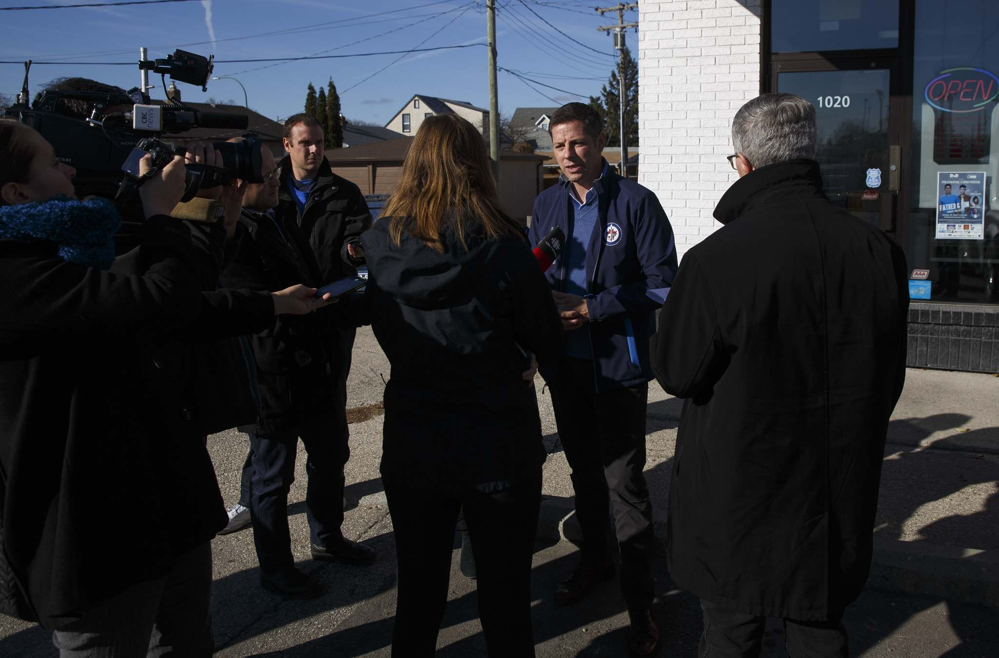 MIKE DEAL / WINNIPEG FREE PRESS</p><p>Incumbent Brian Bowman talks to the media outside of Sugar Blooms and Cakes on McPhillips Street during a stop on his a city-wide blitz Tuesday.</p>